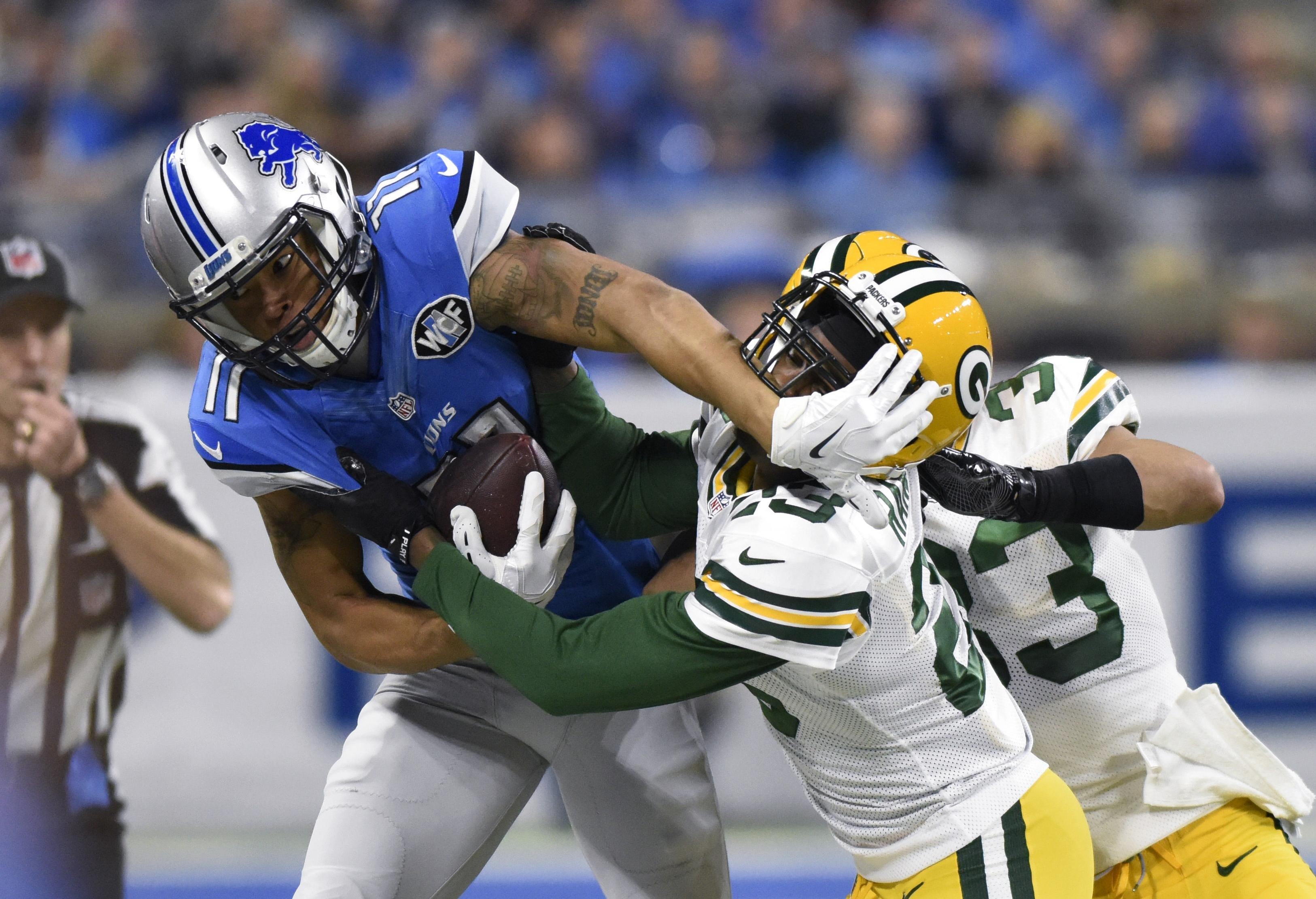 Detroit Lions wide receiver Marvin Jones is pushed out of bounds by Green  Bay Packers cornerback c46e87681