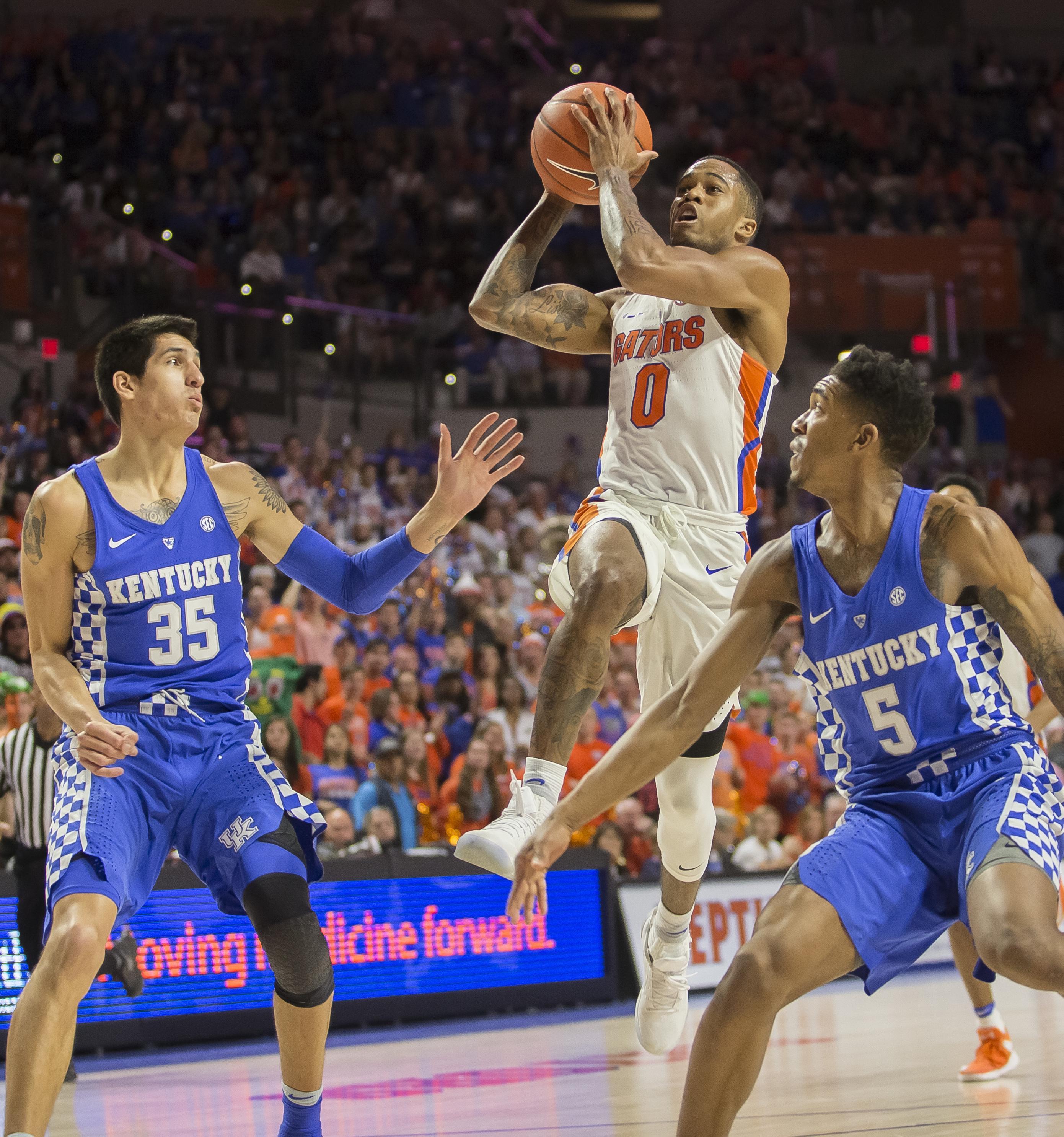 35d3205260e Florida guard Kasey Hill (0) drives to the basket between Kentucky forward  Derek Willis