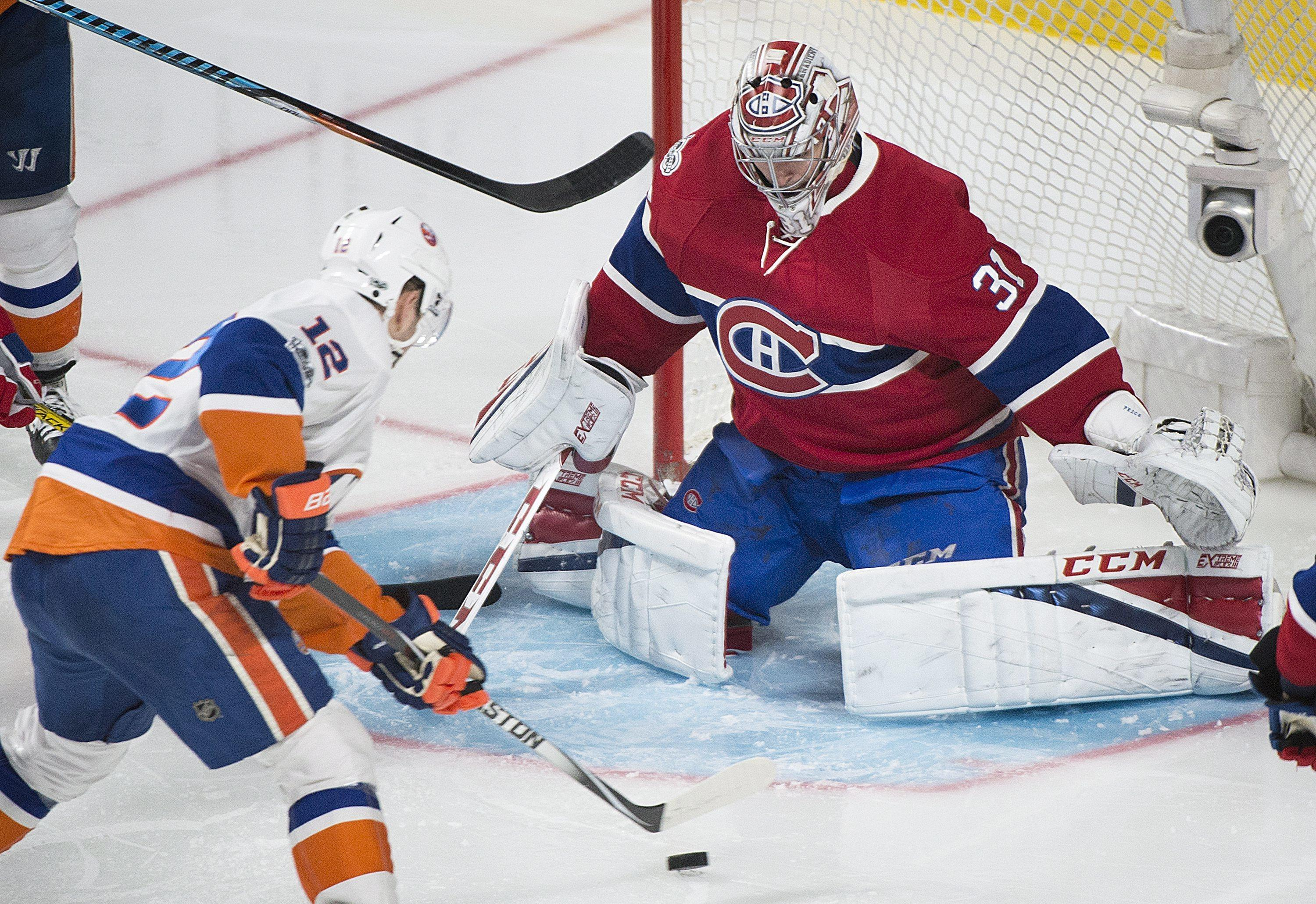 9acdaf29f68 New York Islanders' Josh Bailey moves in on Montreal Canadiens goaltender  Carey Price during the