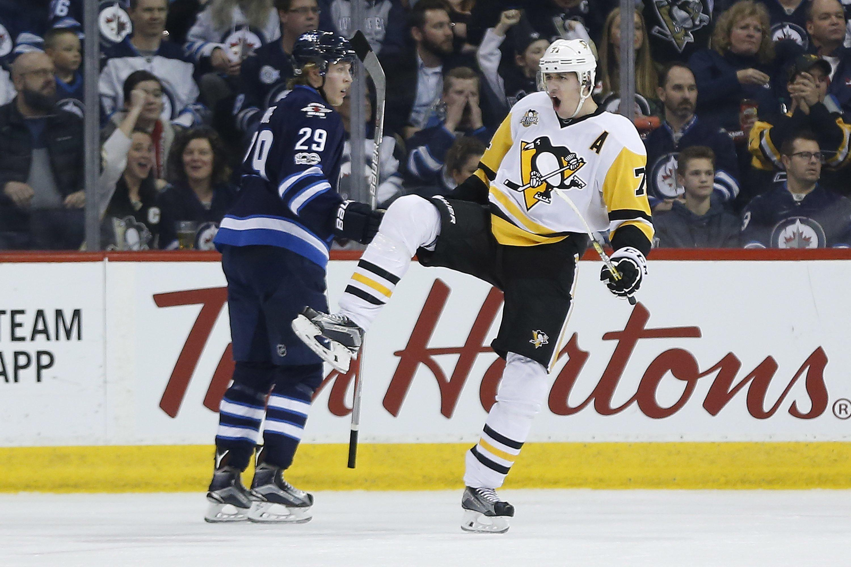 Pittsburgh Penguins  Evgeni Malkin (71) celebrates his goal as Winnipeg  Jets  Patrik f077948c7