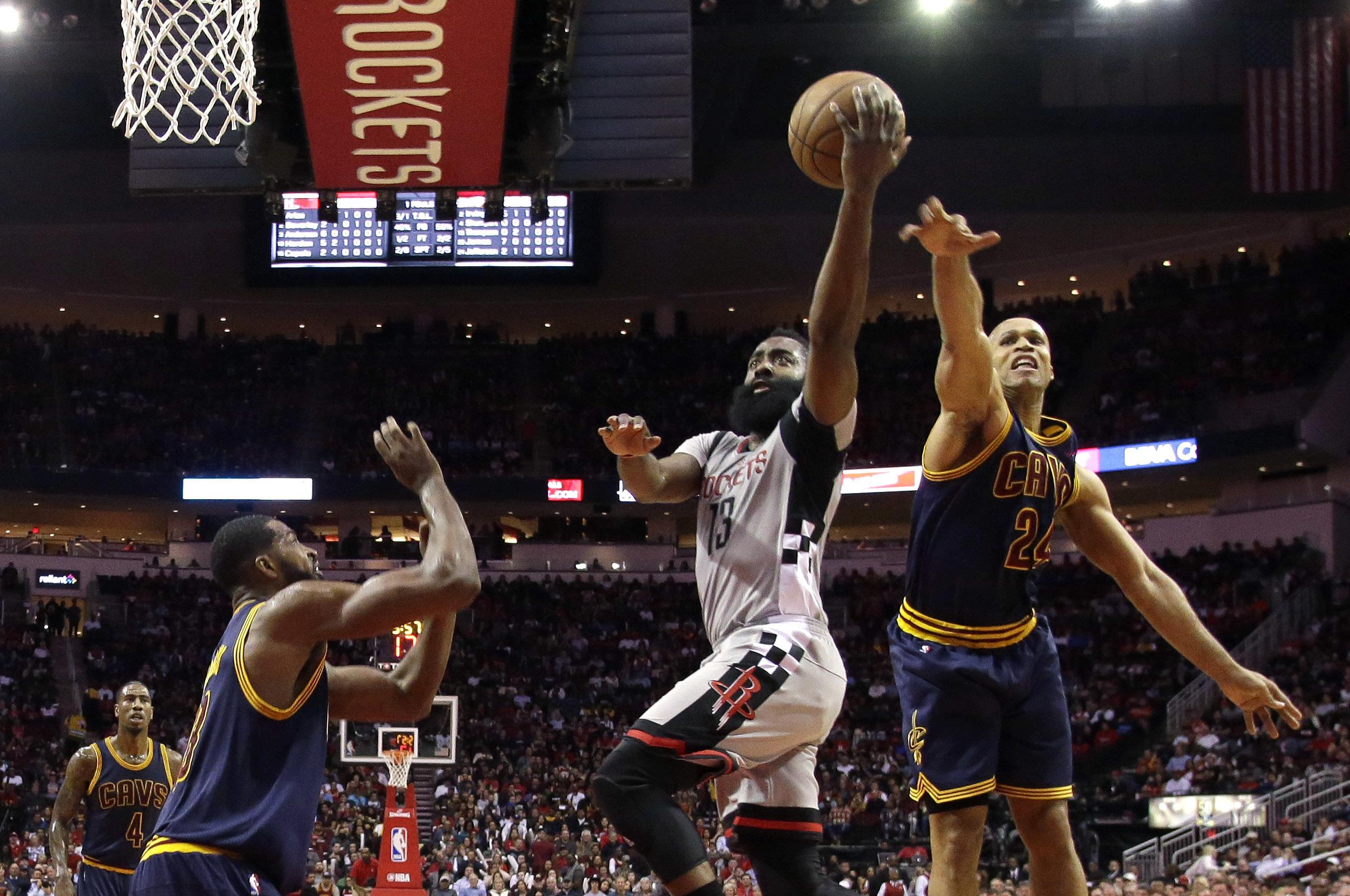 29ad435f8eae Houston Rockets  James Harden (13) goes up for a shot as Cleveland Cavaliers