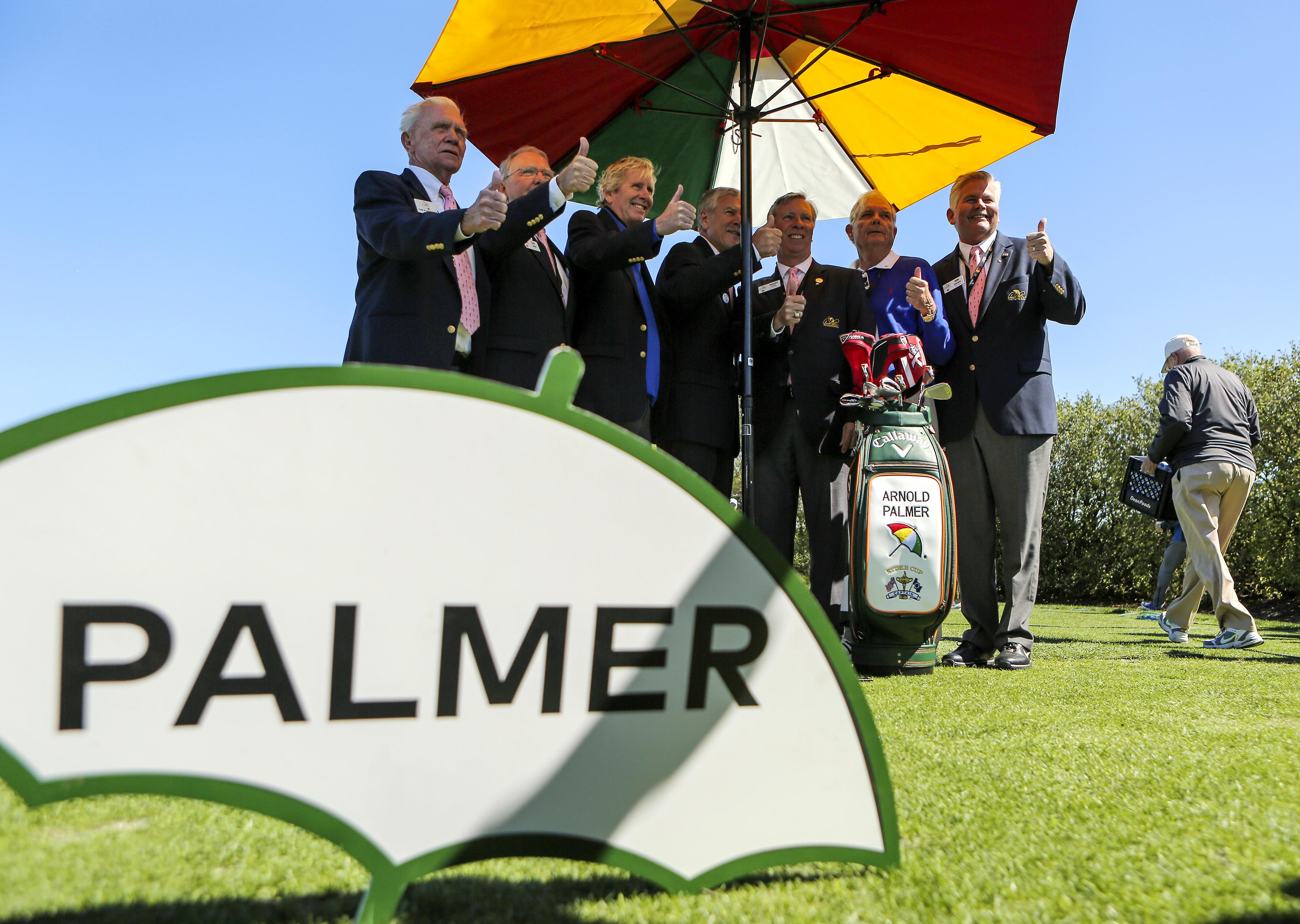 Arnold Palmer Invitational officials pose for a photo with Arnold Palmer's golf bag on Wednesday morning