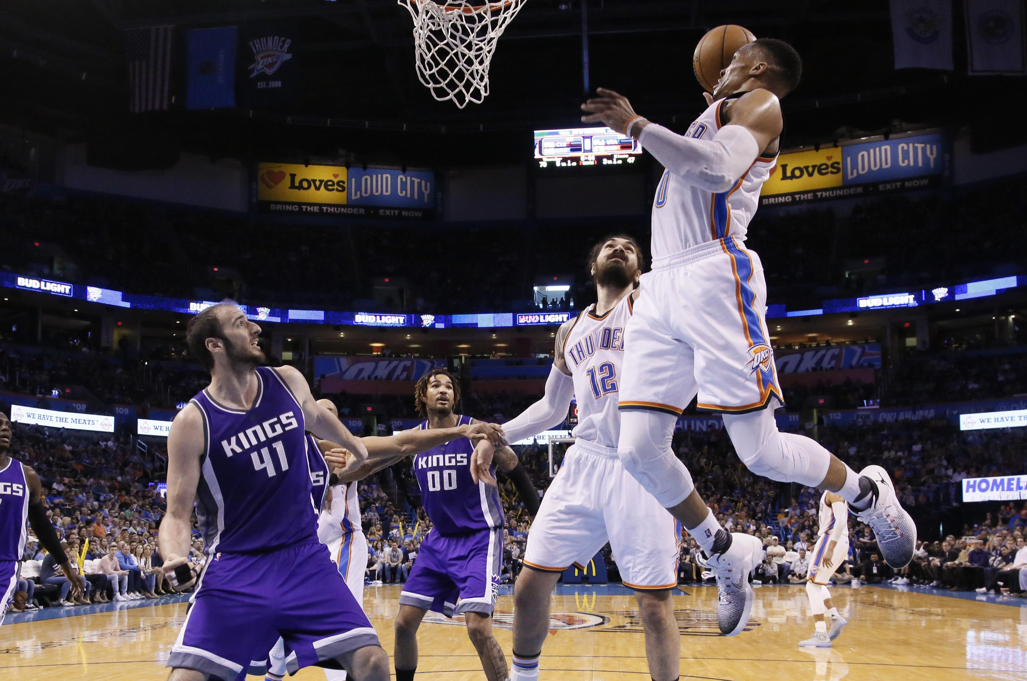 344616a1fa14 Oklahoma City Thunder guard Russell Westbrook (0) goes up for a dunk in  front