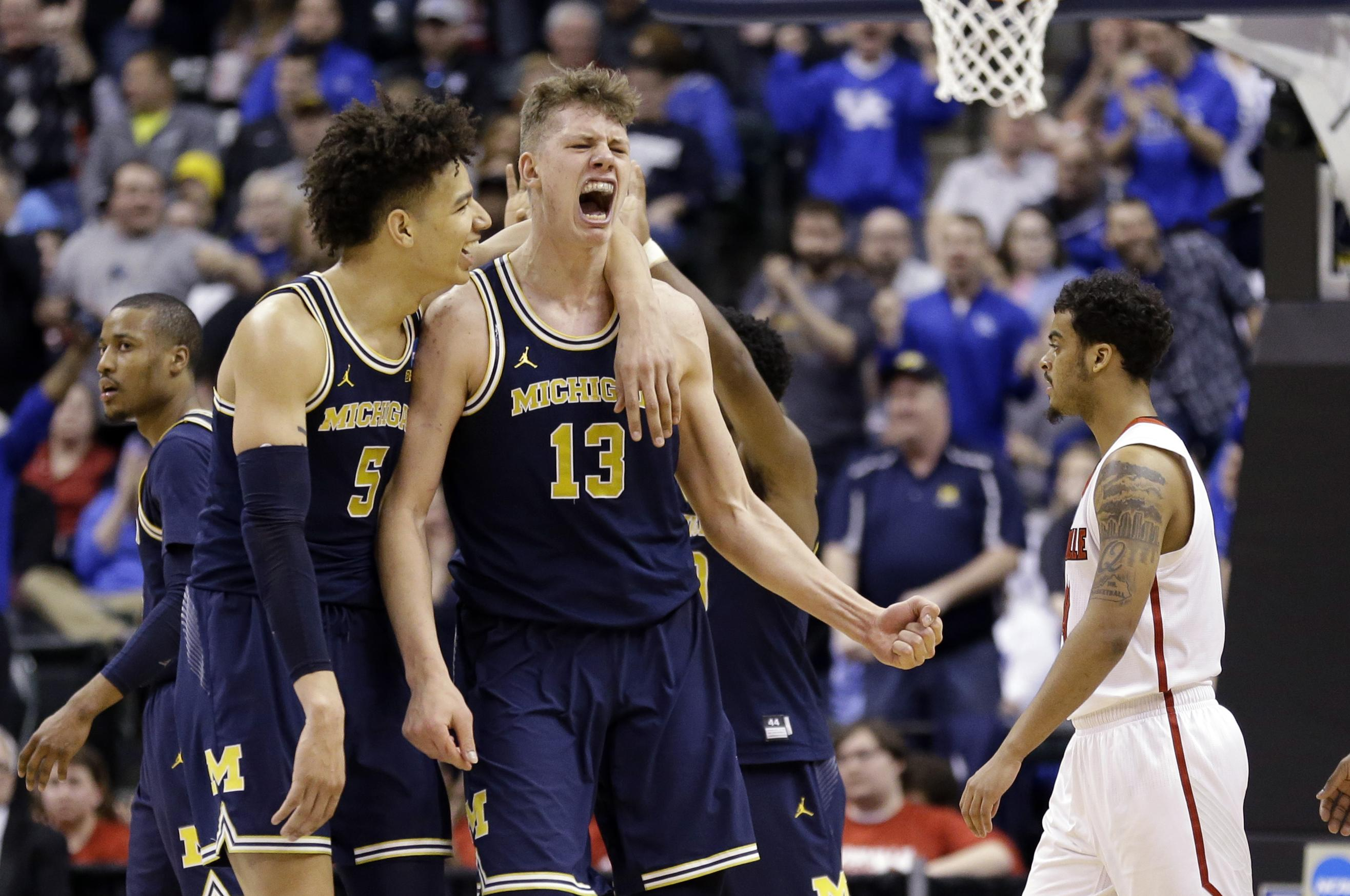 af66cb141ca Michigan forwards D.J. Wilson (5) and Moritz Wagner (13) celebrate during  the