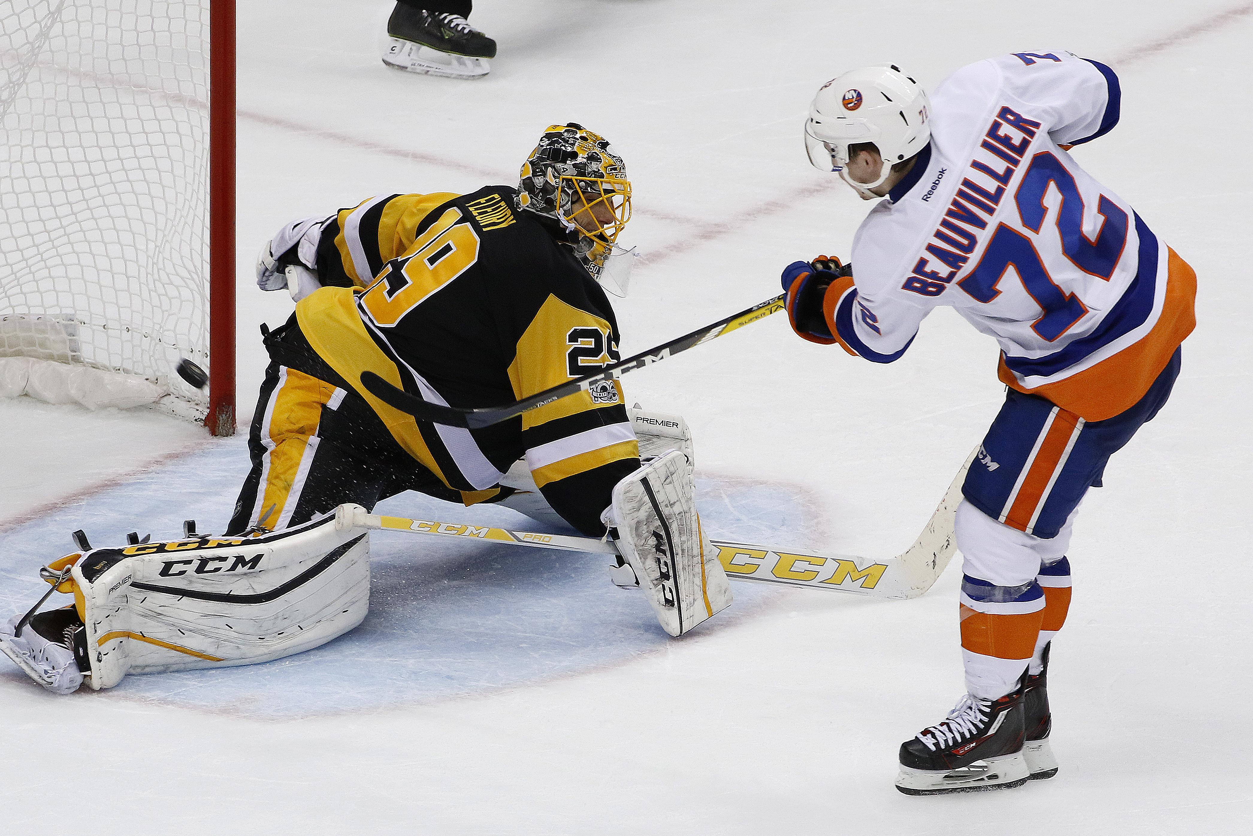 New York Islanders  Anthony Beauvillier (72) scores against Pittsburgh  Penguins goalie Marc- a86dd1acf