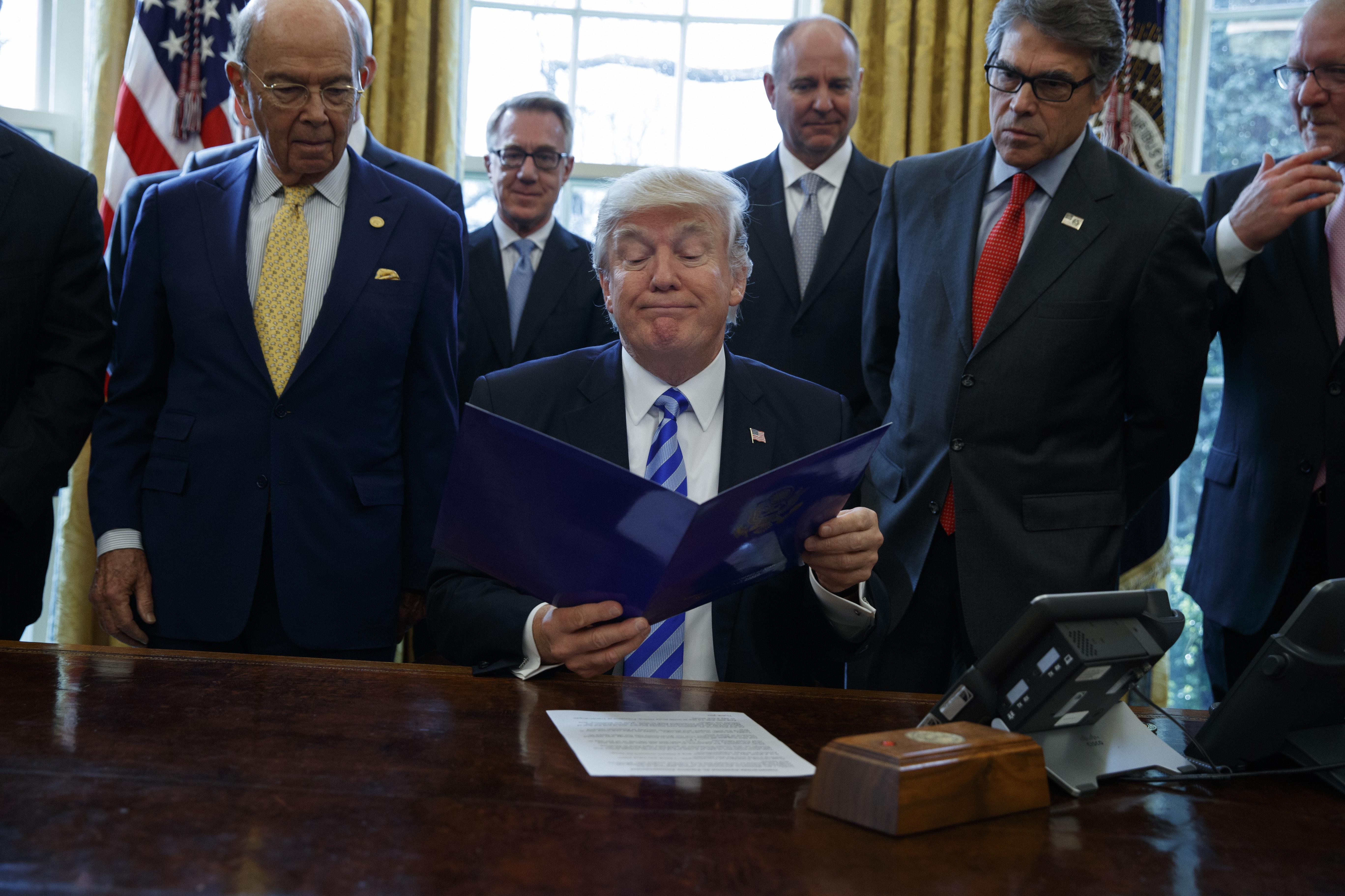President Donald Trump, Flanked By Commerce Secretary Wilbur Ross, Left,  And Energy Secretary