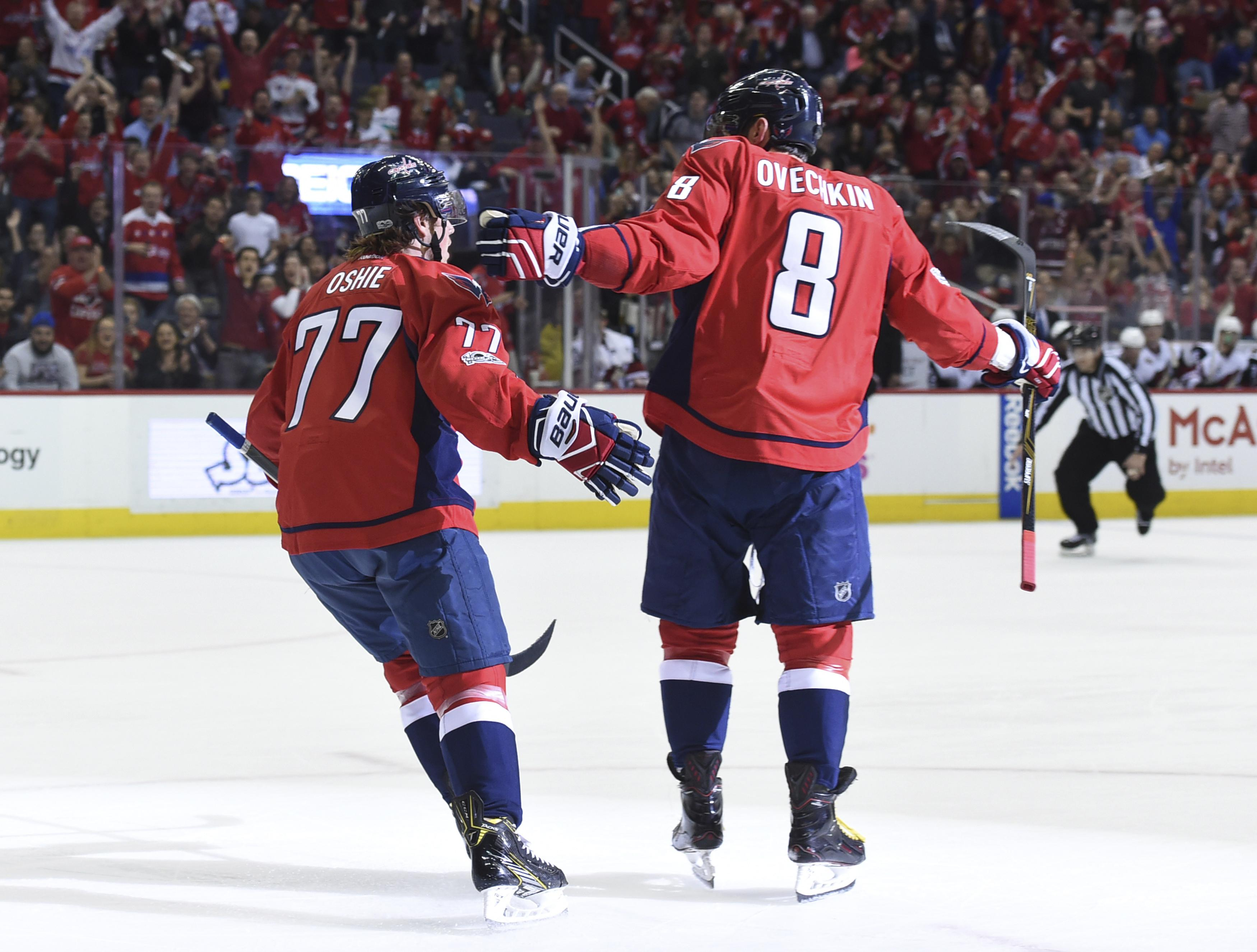 897d7b7b1f2 Washington s Alex Ovechkin (right) celebrates his goal with T.J. Oshie  during Saturday s win against