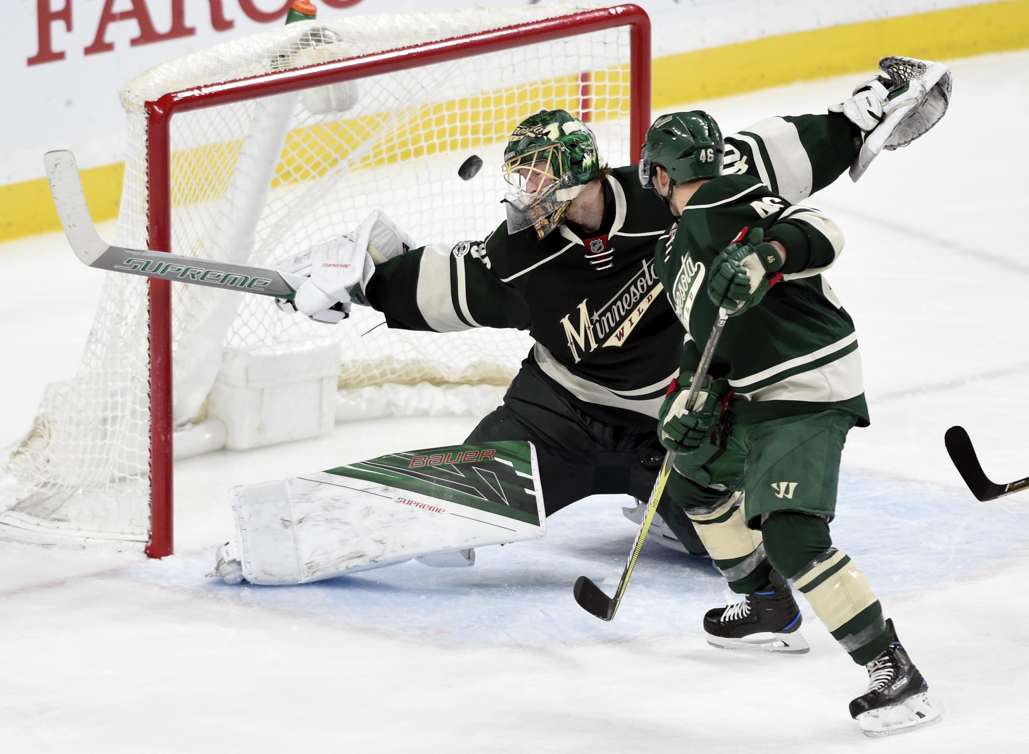 06a2706d985 Minnesota Wild goalie Devan Dubnyk (40) and defenseman Jared Spurgeon (46)  watch