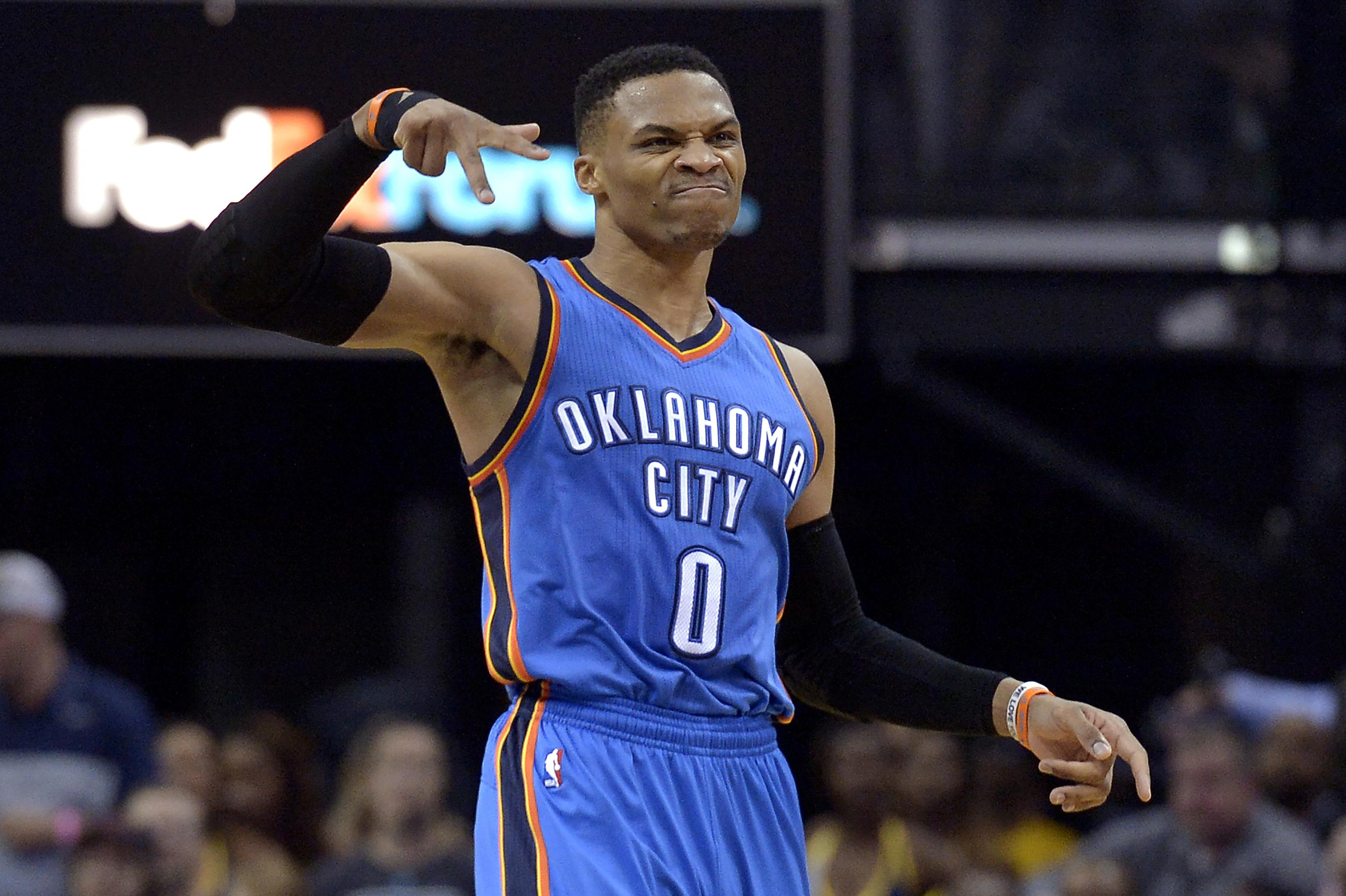 825b5676198b Oklahoma City Thunder guard Russell Westbrook (0) gestures after scoring a  3-pointer