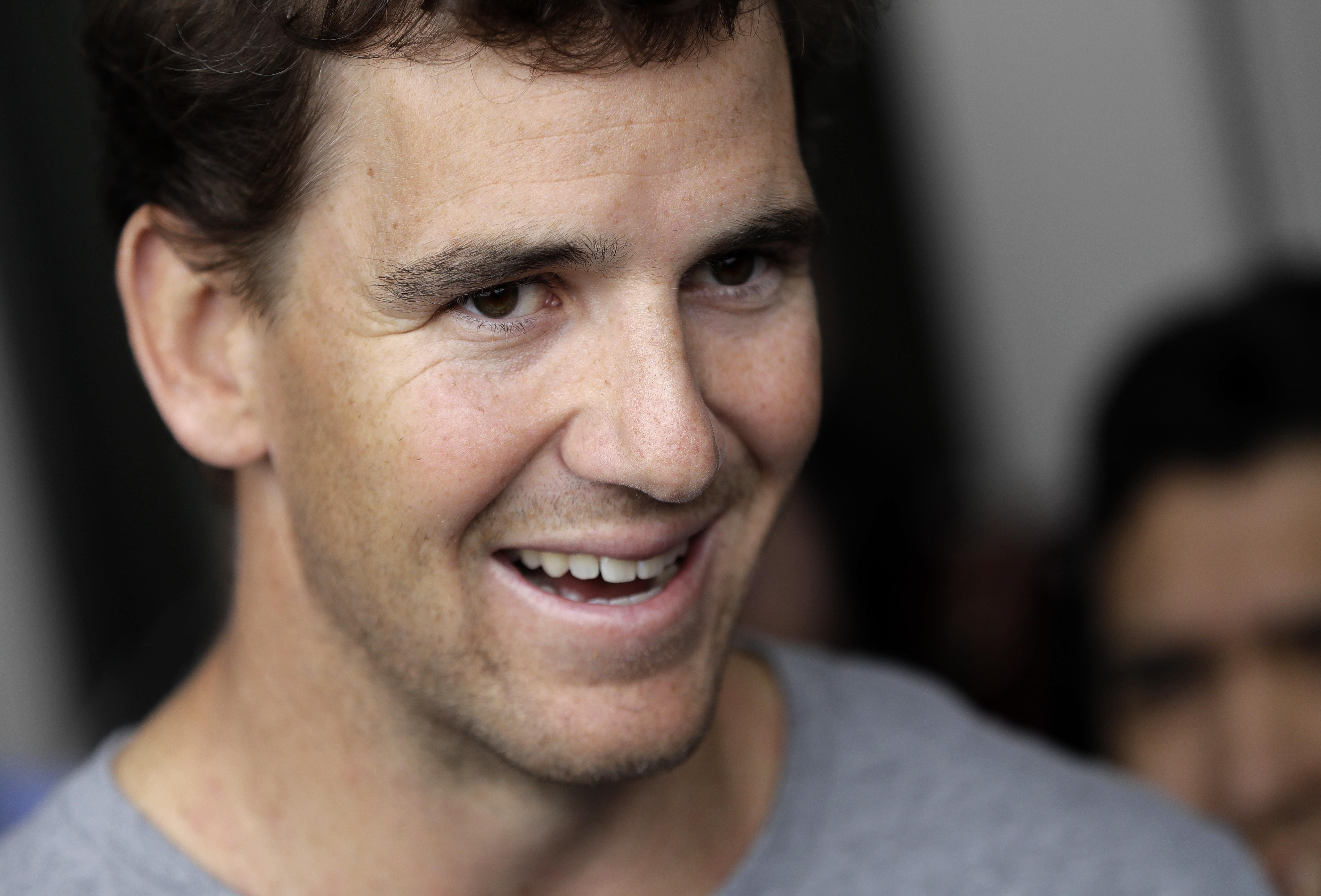 New York Giants quarterback Eli Manning talks to reporters during an  availability ahead of the NFL 9a703ce89