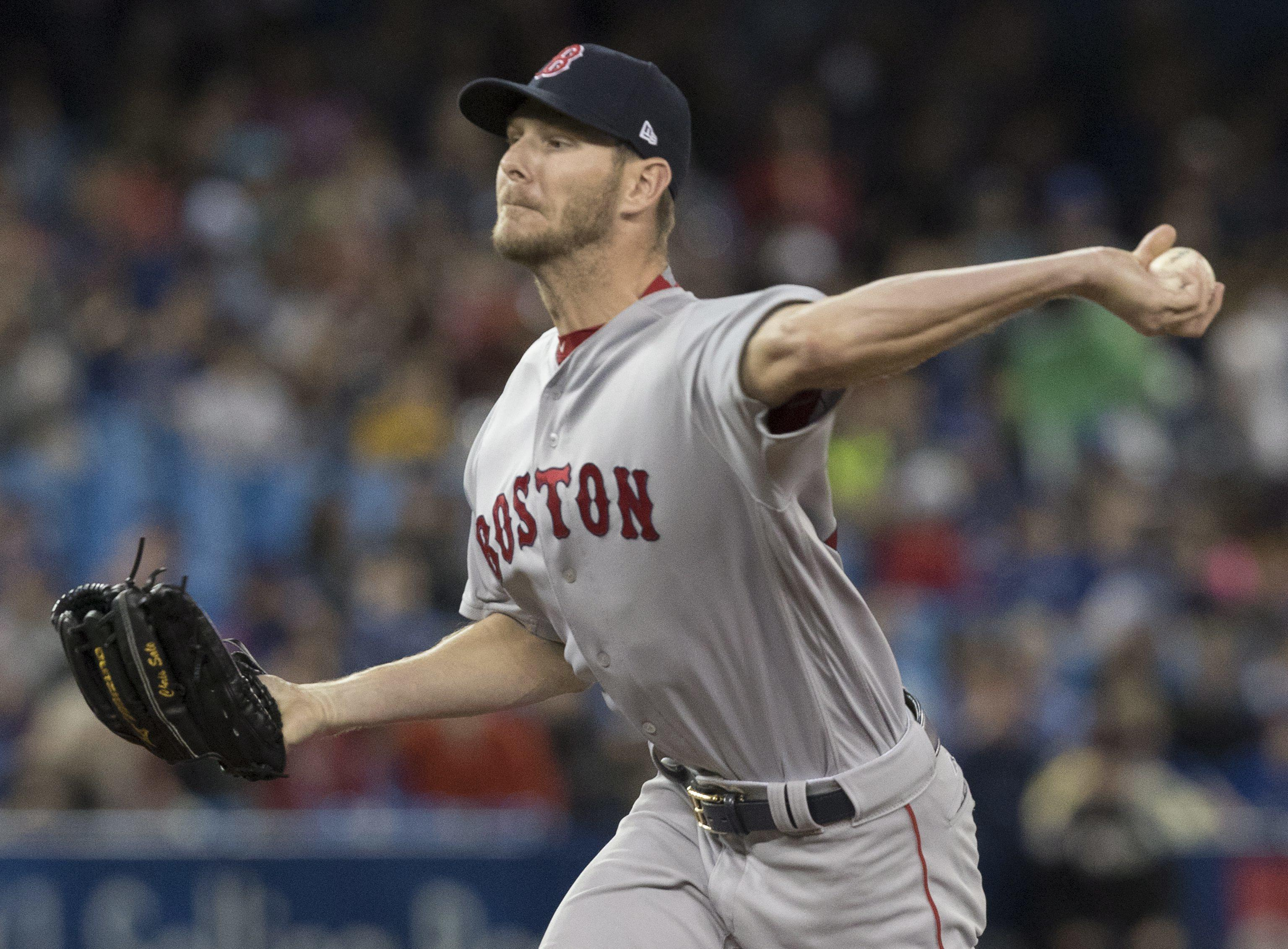ffd510e7aa0 Boston Red Sox starting pitcher Chris Sale throws against the Toronto Blue  Jays on Thursday.
