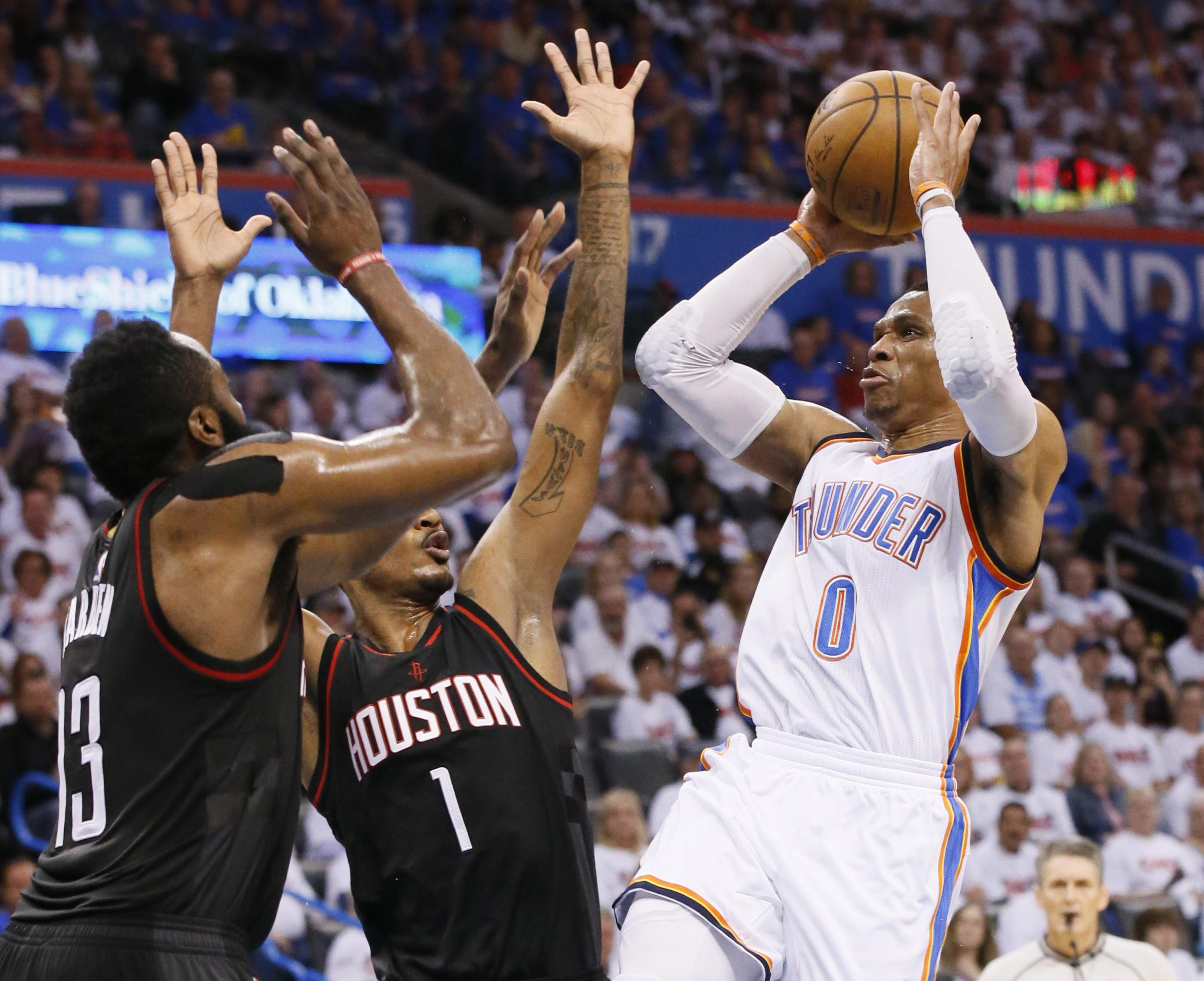 801548b34fd Oklahoma City Thunder guard Russell Westbrook (0) shoots as Houston Rockets  guard James Harden