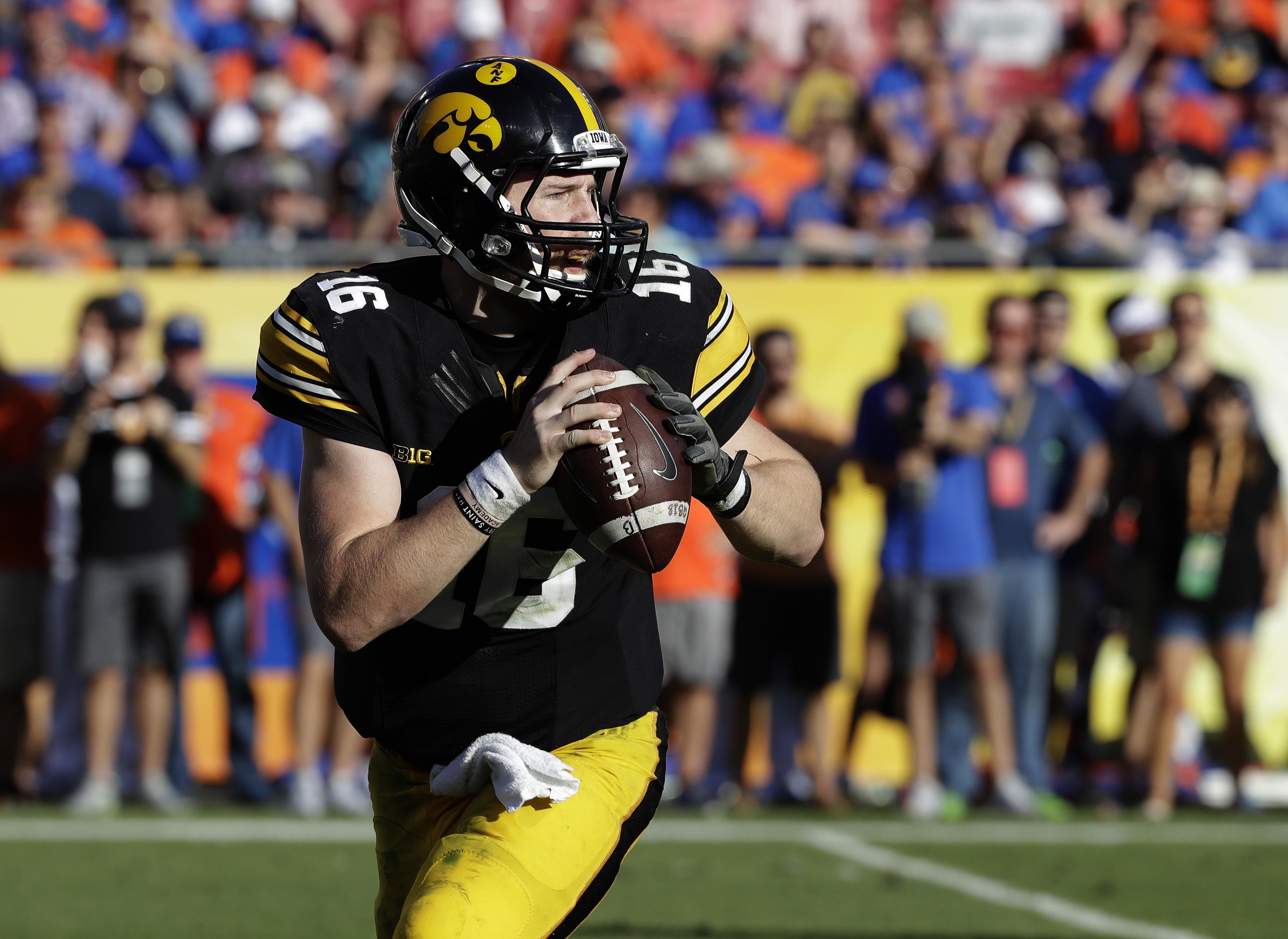 e96872aa6 Iowa quarterback C.J. Beathard during the second half of the Outback Bowl  NCAA college football game