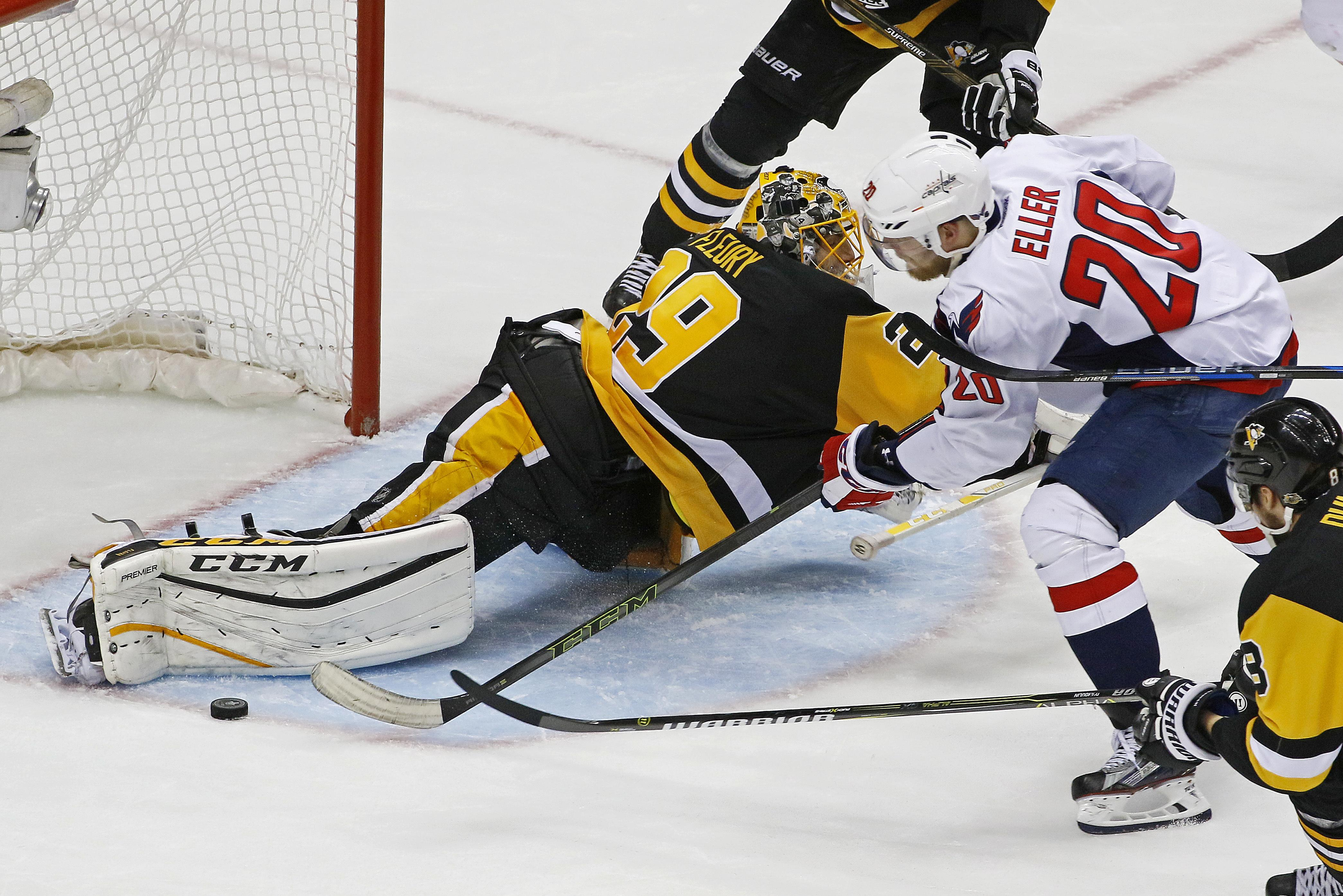 Pittsburgh Penguins goalie Marc-Andre Fleury blocks a shot by Washington  Capitals  Lars Eller ac64fe44d