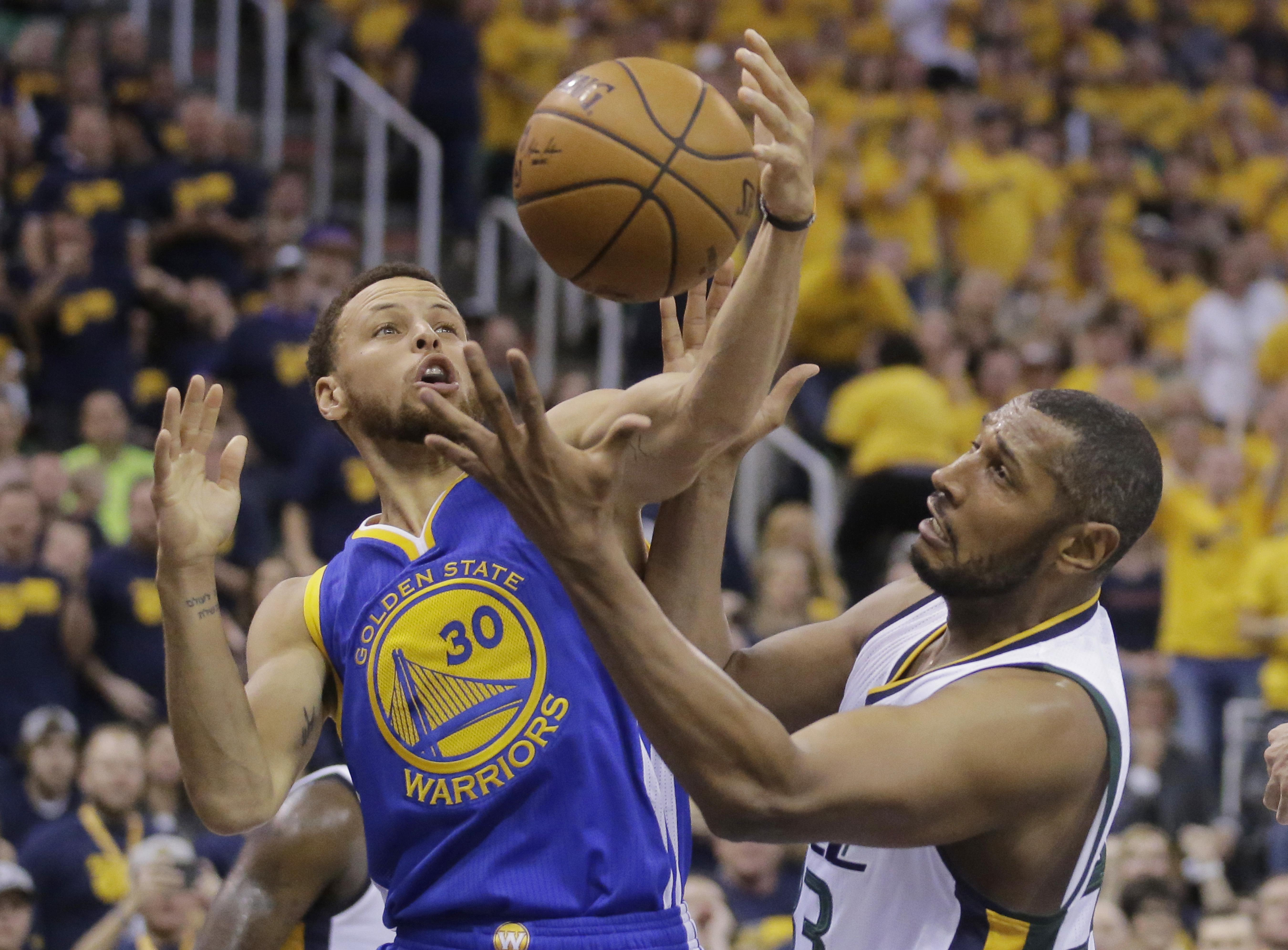 20cf5bdee98 Golden State Warriors guard Stephen Curry (30) and Utah Jazz center Boris  Diaw