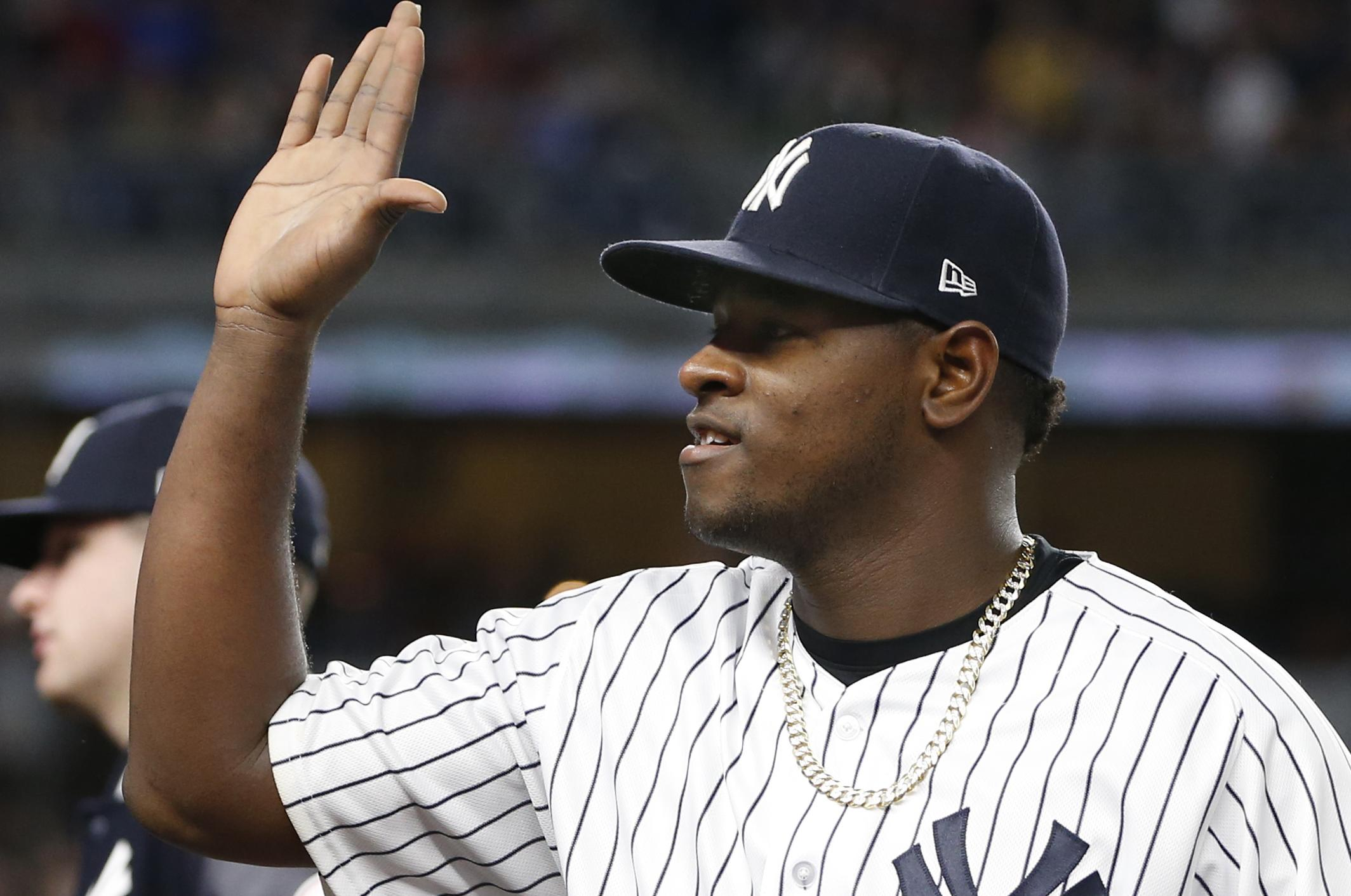 74027166f5e9 New York Yankees starting pitcher Luis Severino greets teammates after he  pitched eight innings in the