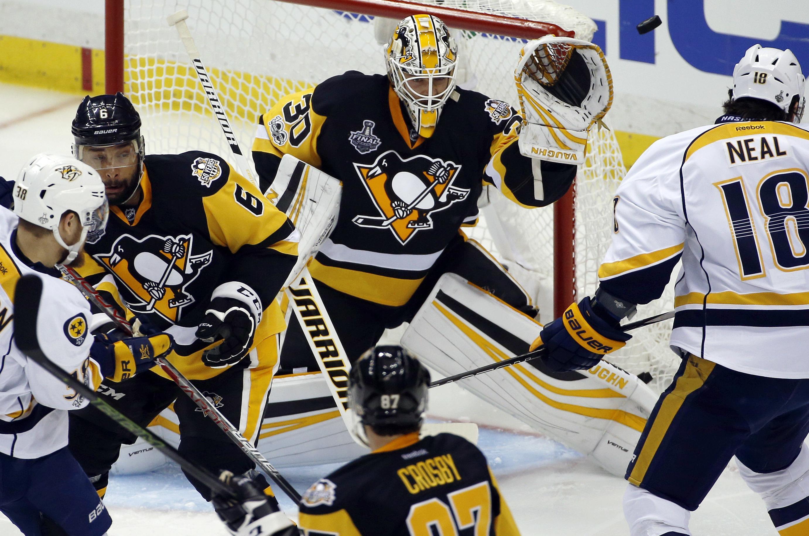 Pittsburgh Penguins goalie Matt Murray turns away a Nashville Predators  shot during the second period in 37162ae43