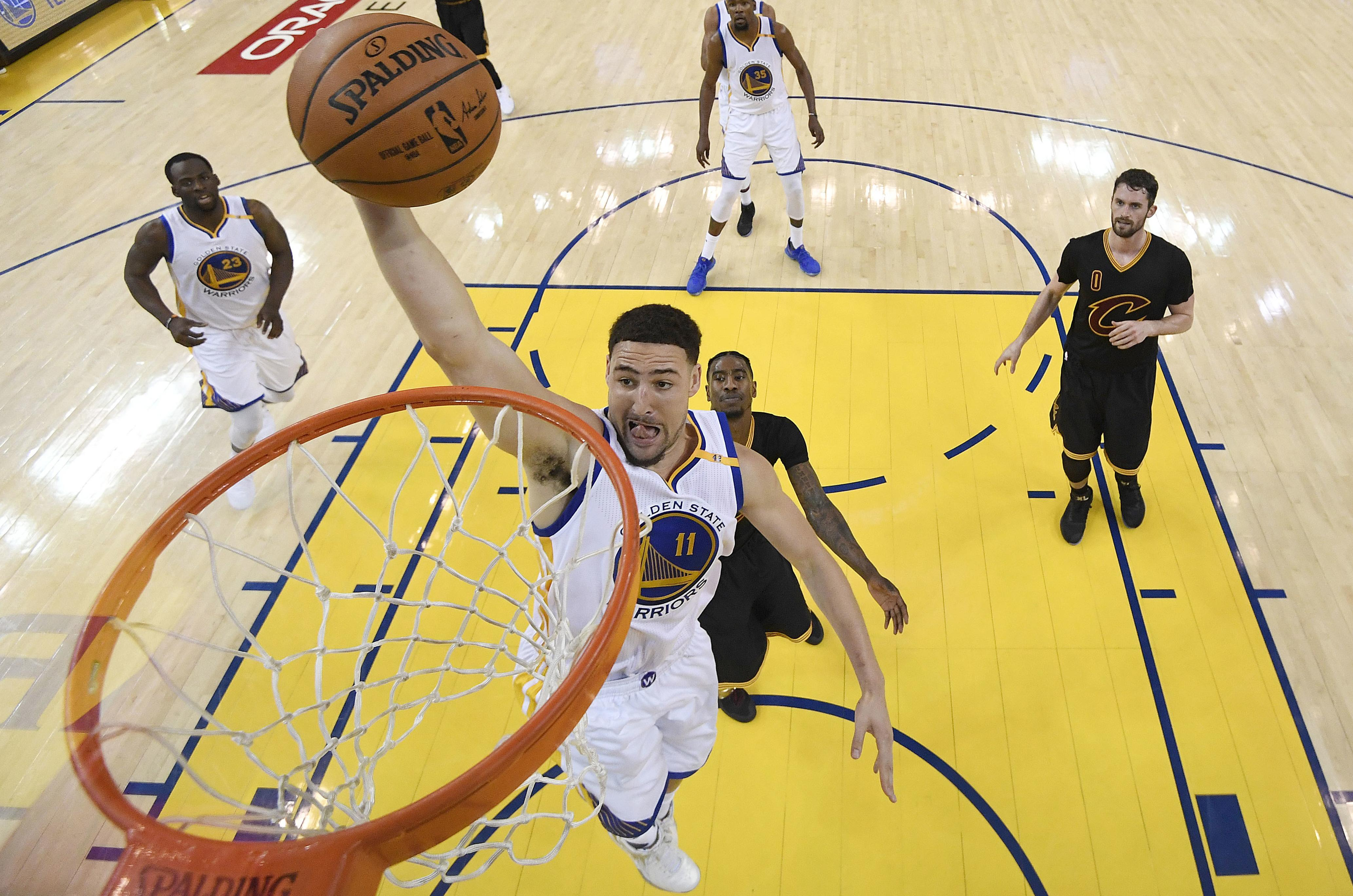 edd395d2d Golden State Warriors guard Klay Thompson goes to the rim against the  Cleveland Cavaliers during the