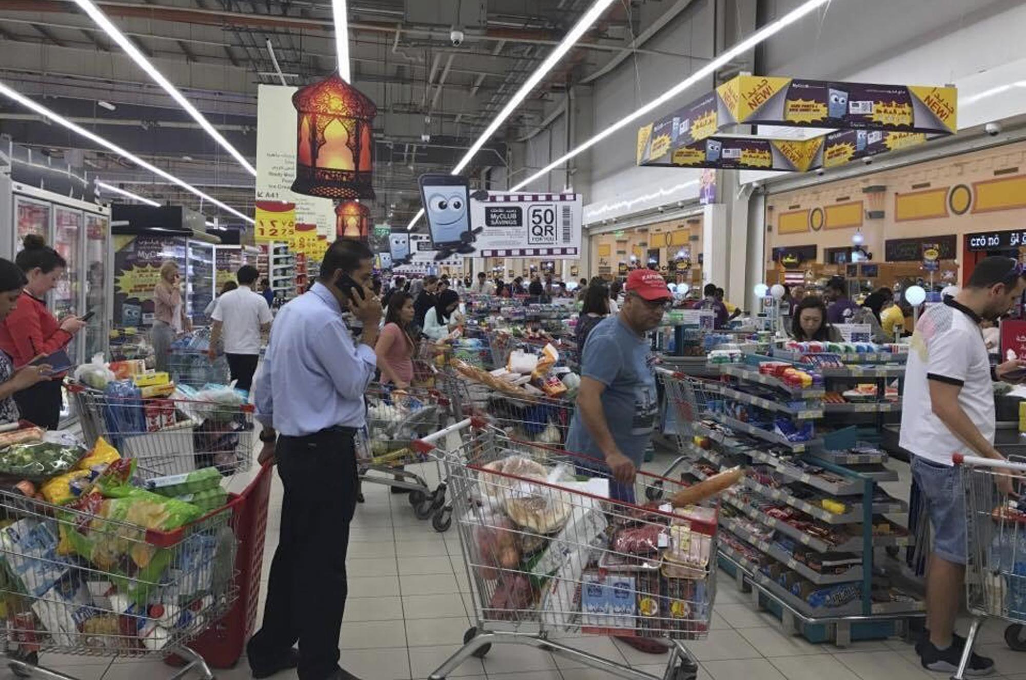 Qatar tries to ease food-supply fears as crowds throng shops