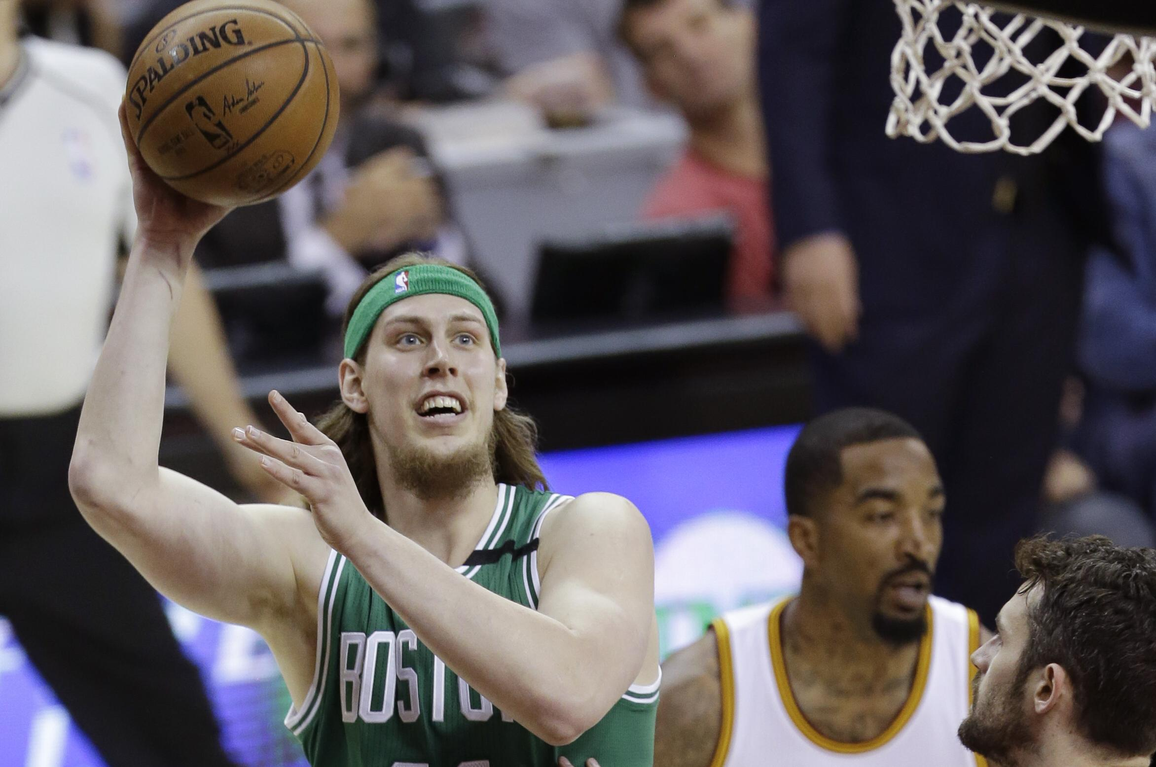 Boston Celtics  Kelly Olynyk (41) shoots against Cleveland Cavaliers  Kevin  Love ( a9e5ad2fe