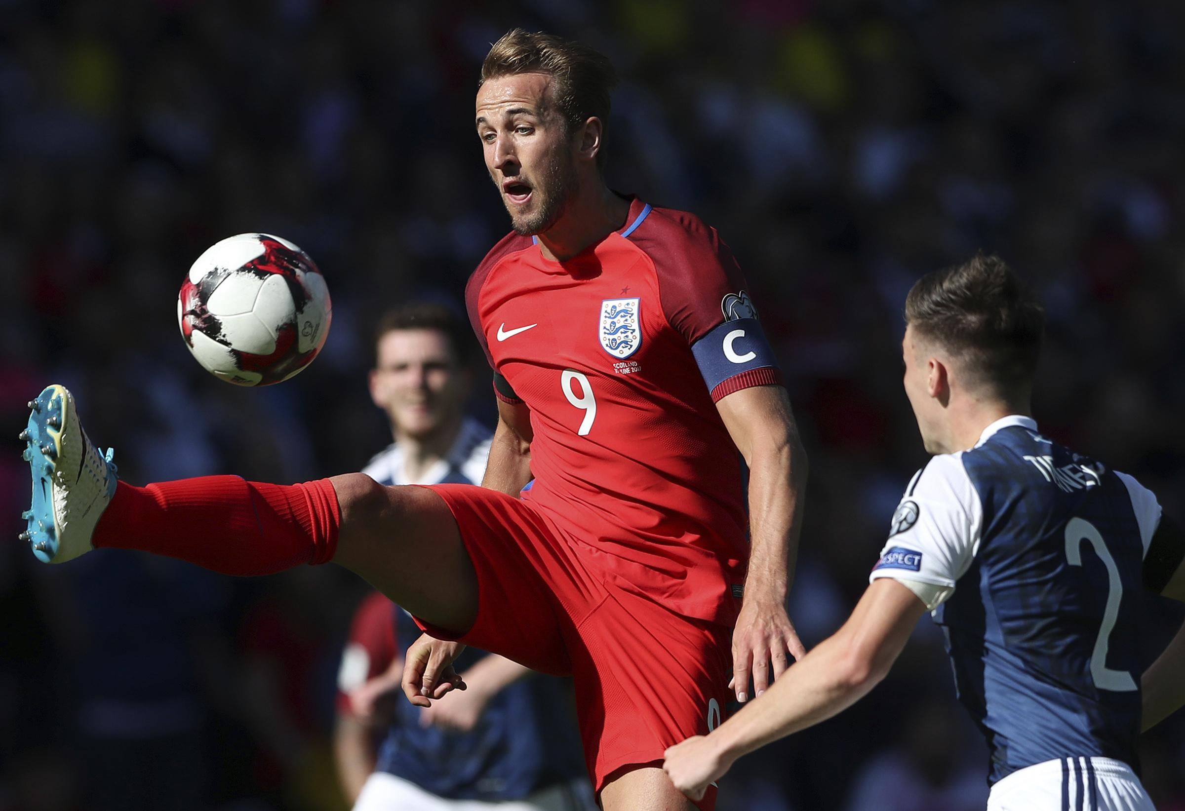 England S Harry Kane Left View For The Ball Next To Scotland Charlie Tierney During