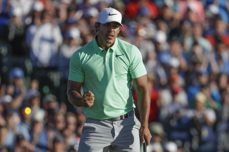 032b8641329f8 Brooks Koepka celebrates after the fourth round of the U.S. Open golf  tournament Sunday