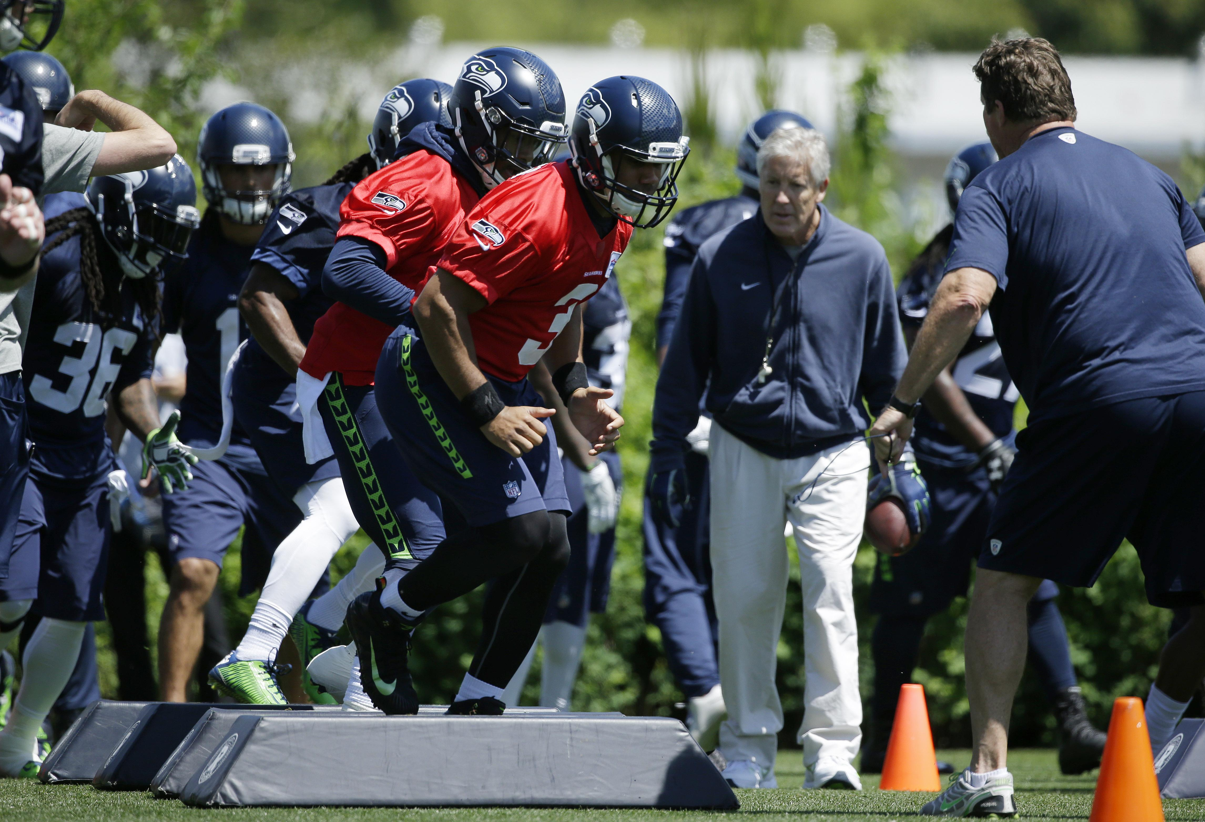 e20245b5d2d Seattle Seahawks head coach Pete Carroll looks on as Seattle Seahawks  quarterback Russell Wilson