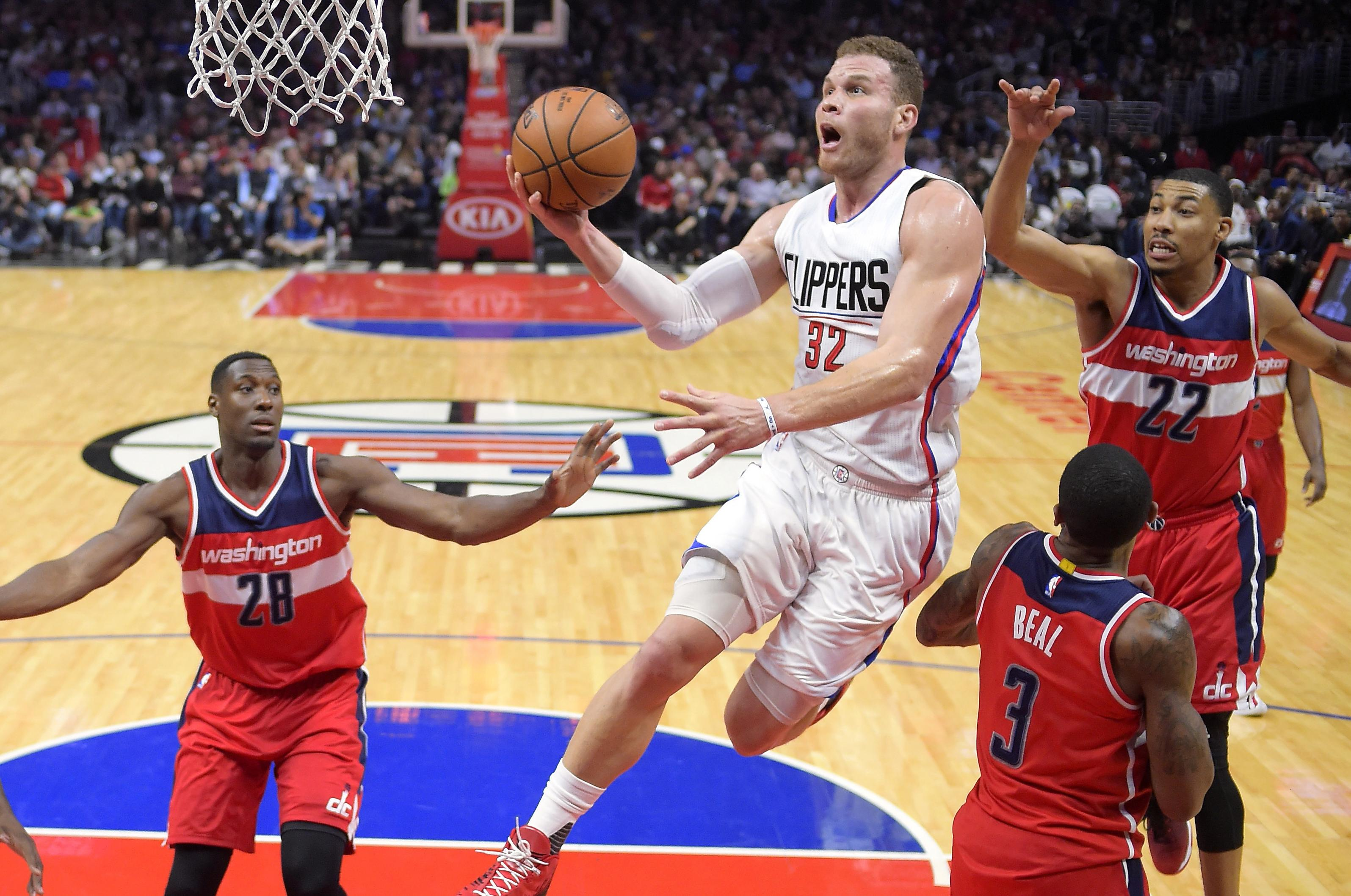 Ap source blake griffin returning to the los angeles clippers the los angeles clippers forward blake griffin second from left shoots as washington wizards center m4hsunfo