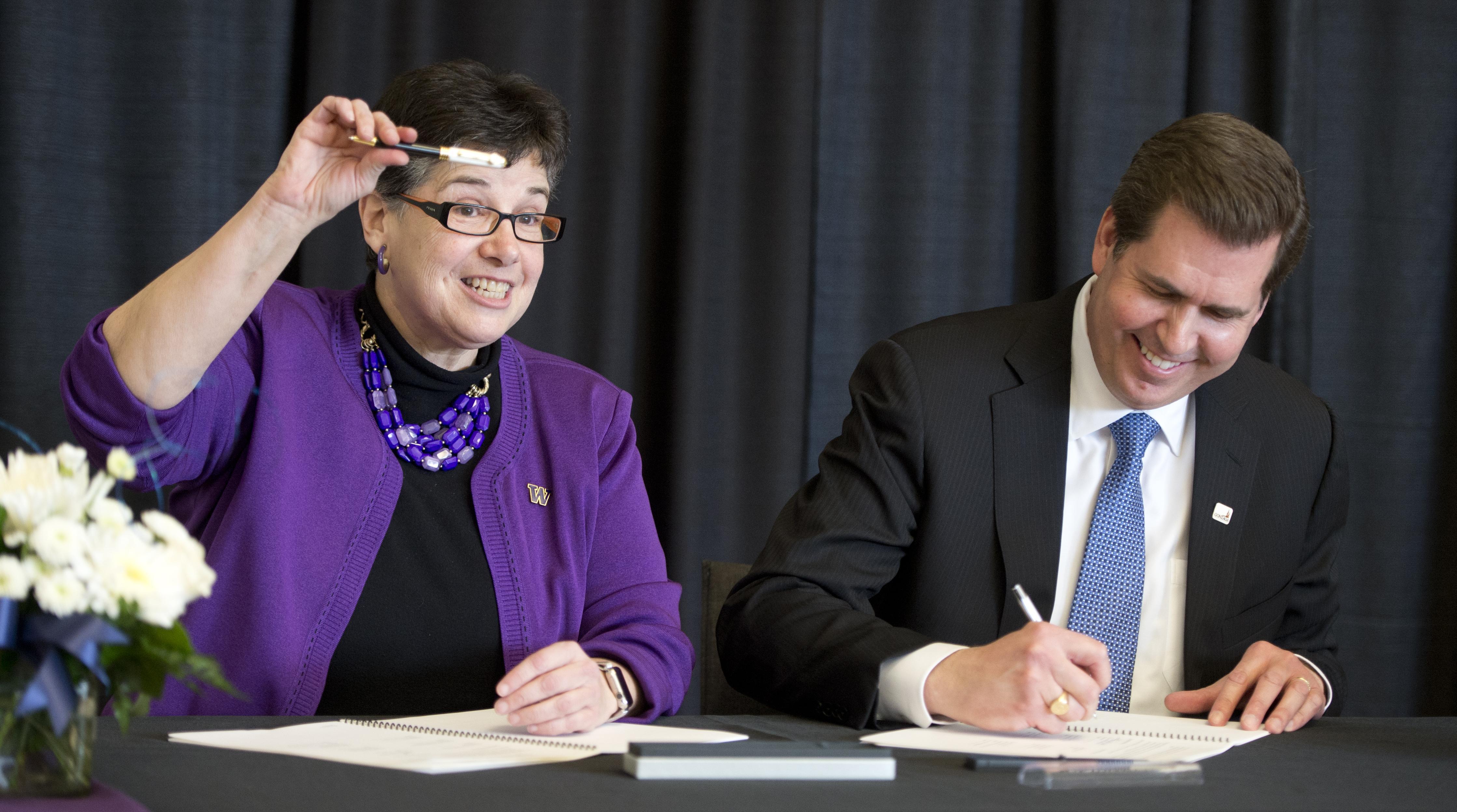 3ee6ecc1b8 University of Washington President Ana Marie Cauce, left, shows off her  Gonzaga pen while