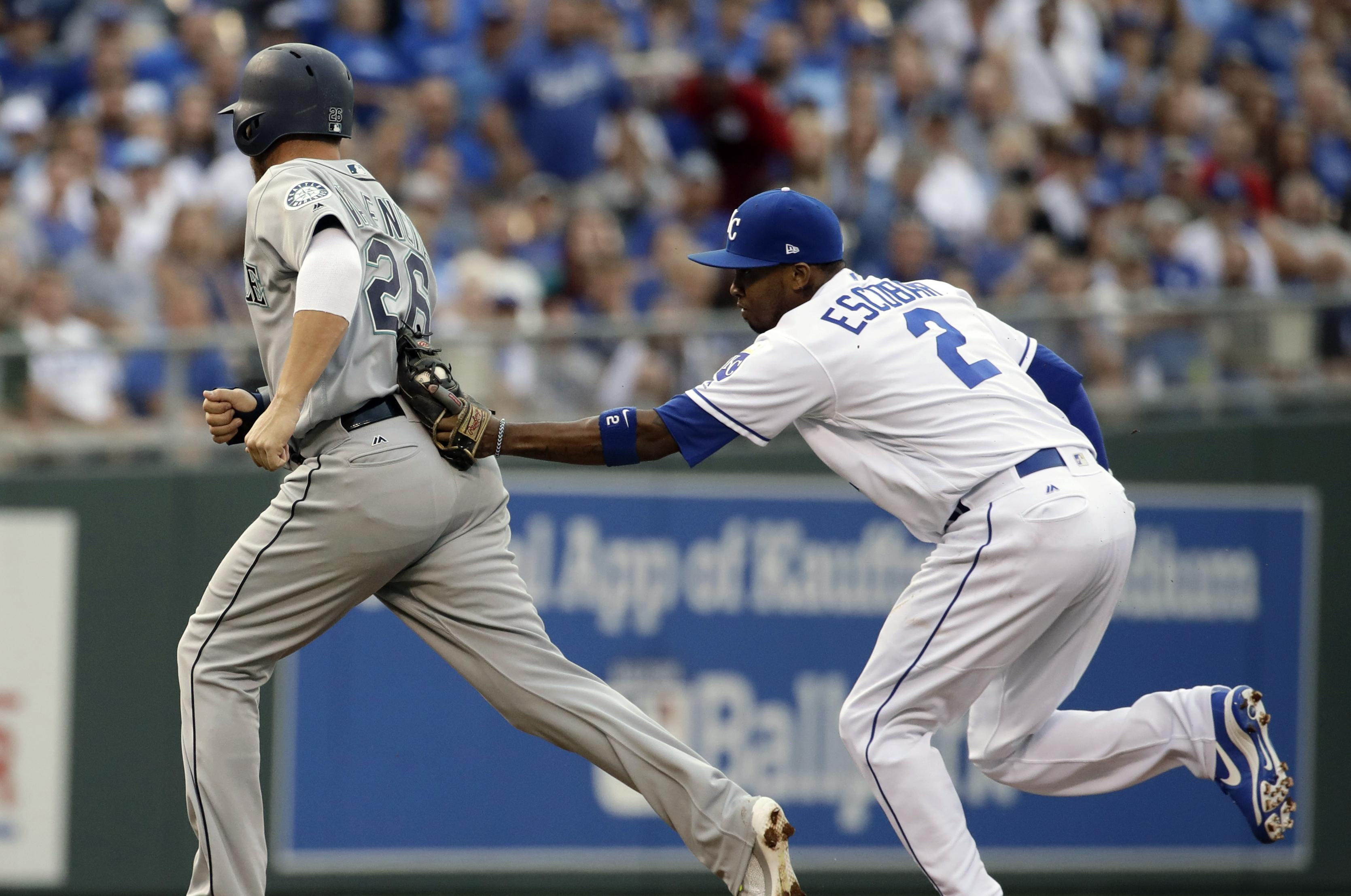 9372eb7bec5 Kansas City Royals shortstop Alcides Escobar (2) tags Seattle Mariners   Danny Valencia (