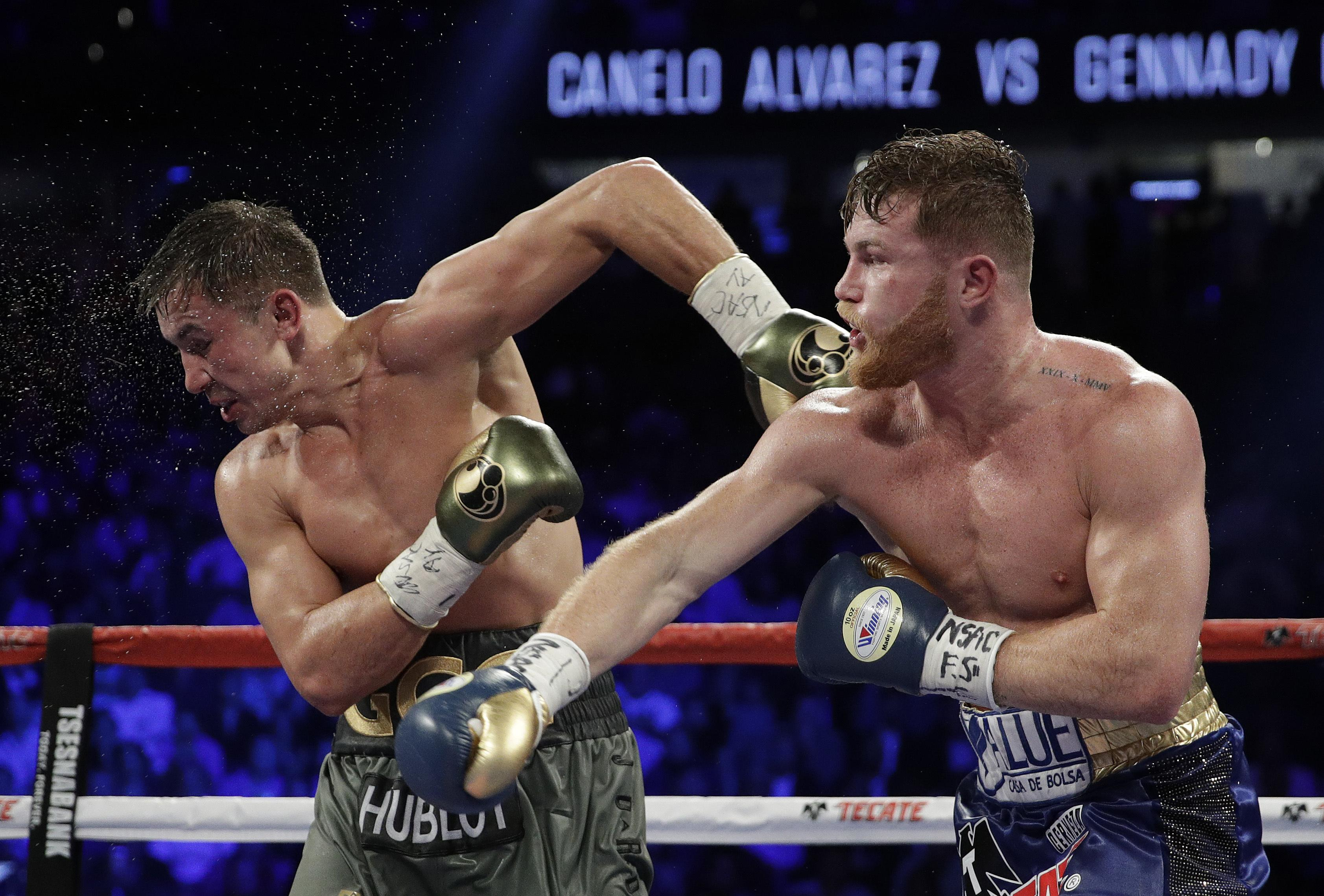 Canelo Alvarez, right, fights Gennady Golovkin during a middleweight title  fight Sunday, Sept