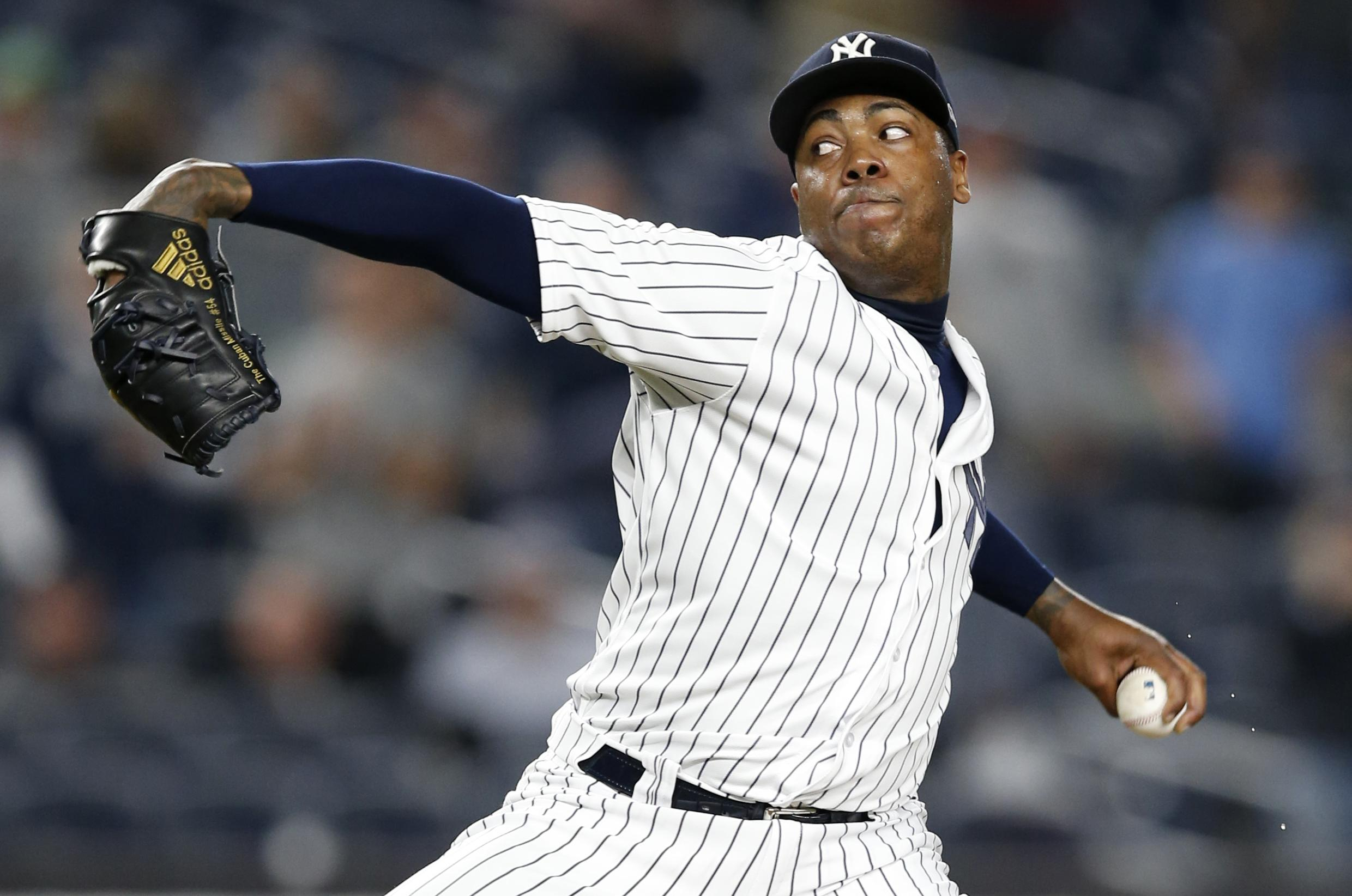 ea88526cf81 New York reliever Aroldis Chapman pitched out of a huge jam in the eighth  inning to