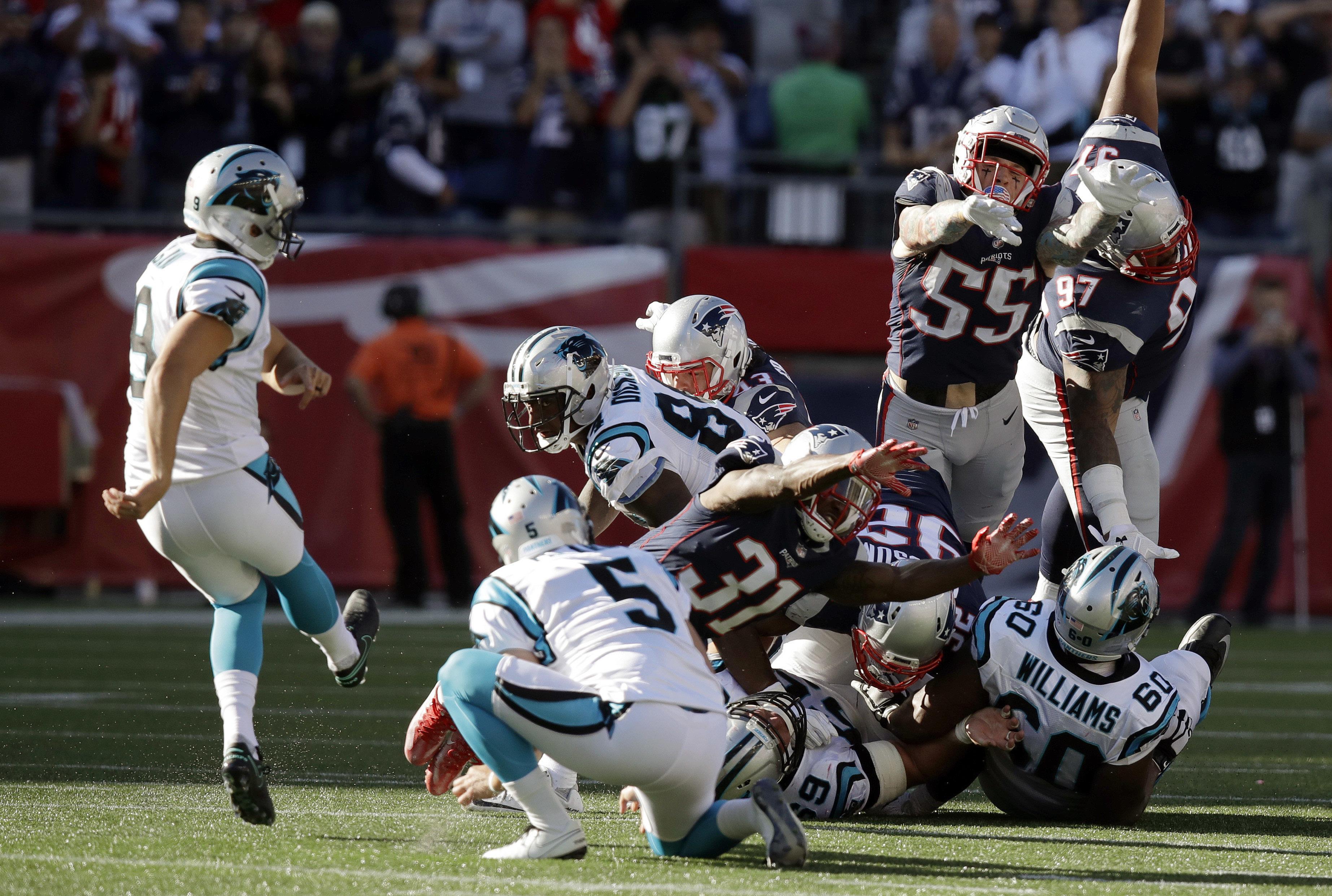 on sale 4b078 023d8 Carolina Panthers kicker Graham Gano, left, kicks the game-winning field  goal as