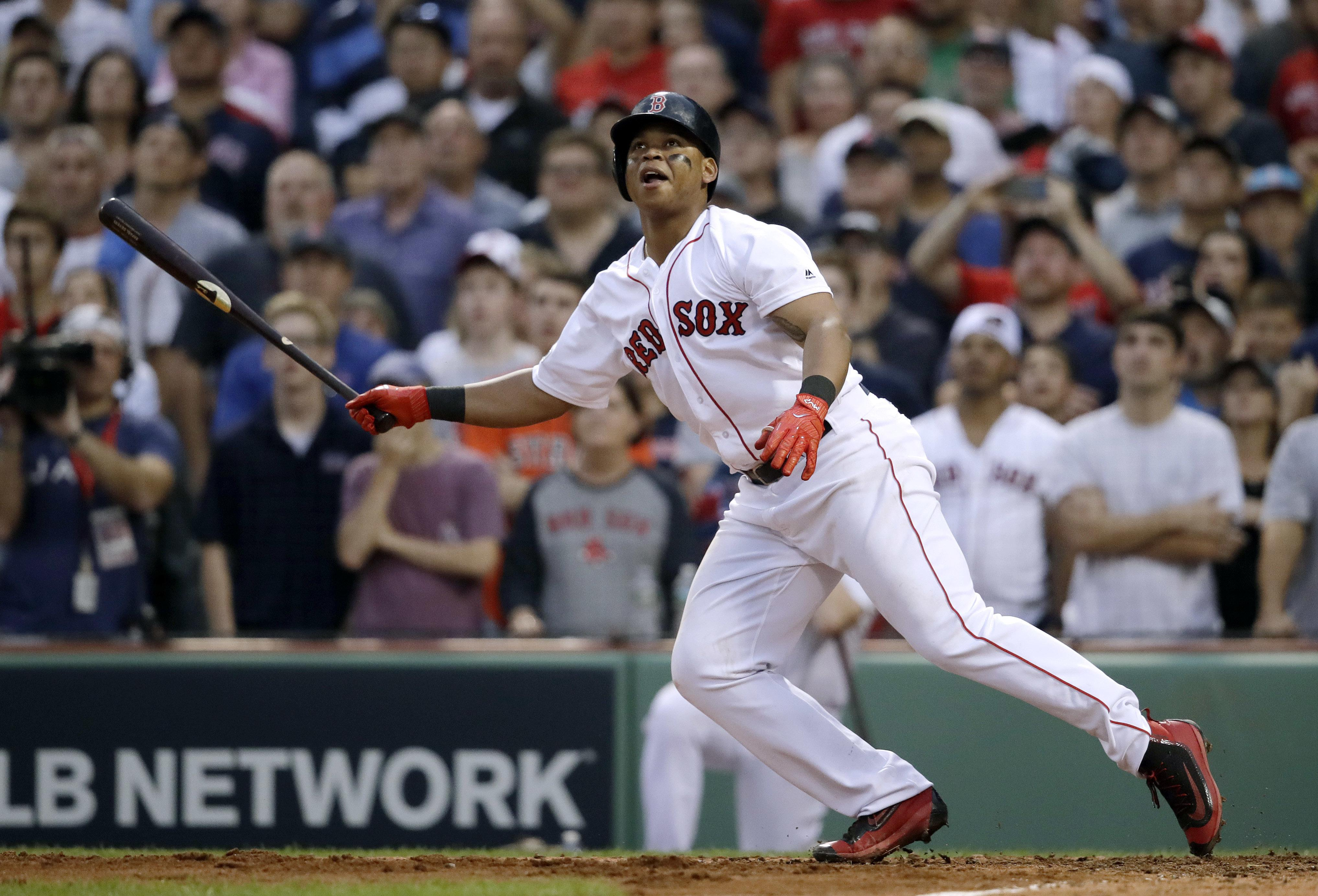 0416ba6d6b8ce Boston s Rafael Devers watches his RBI single to left field during the  seventh inning of Game