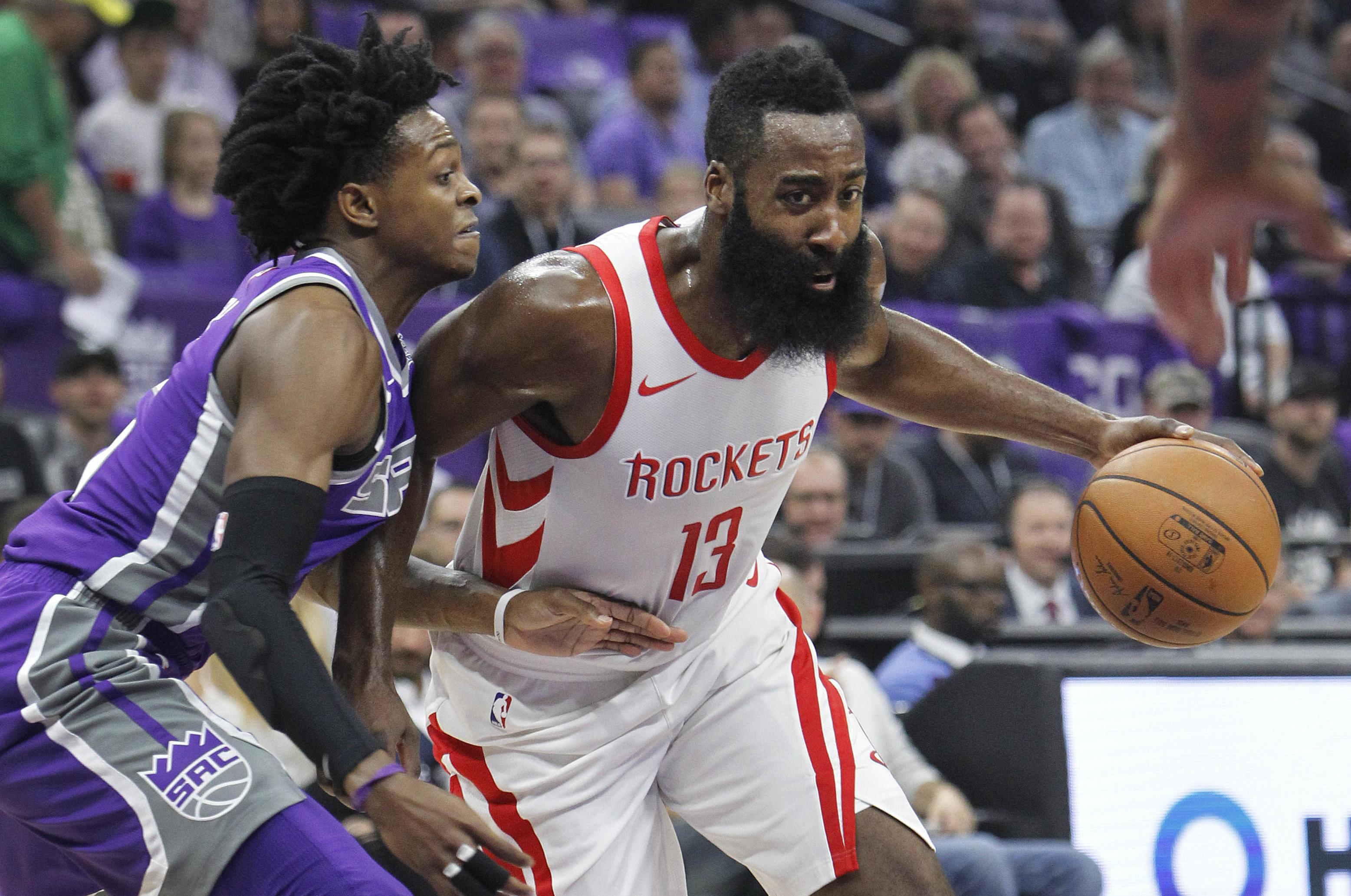ad5f9ff49470 Houston Rockets guard James Harden (13) drives around Sacramento Kings  defender DeAaron Fox (