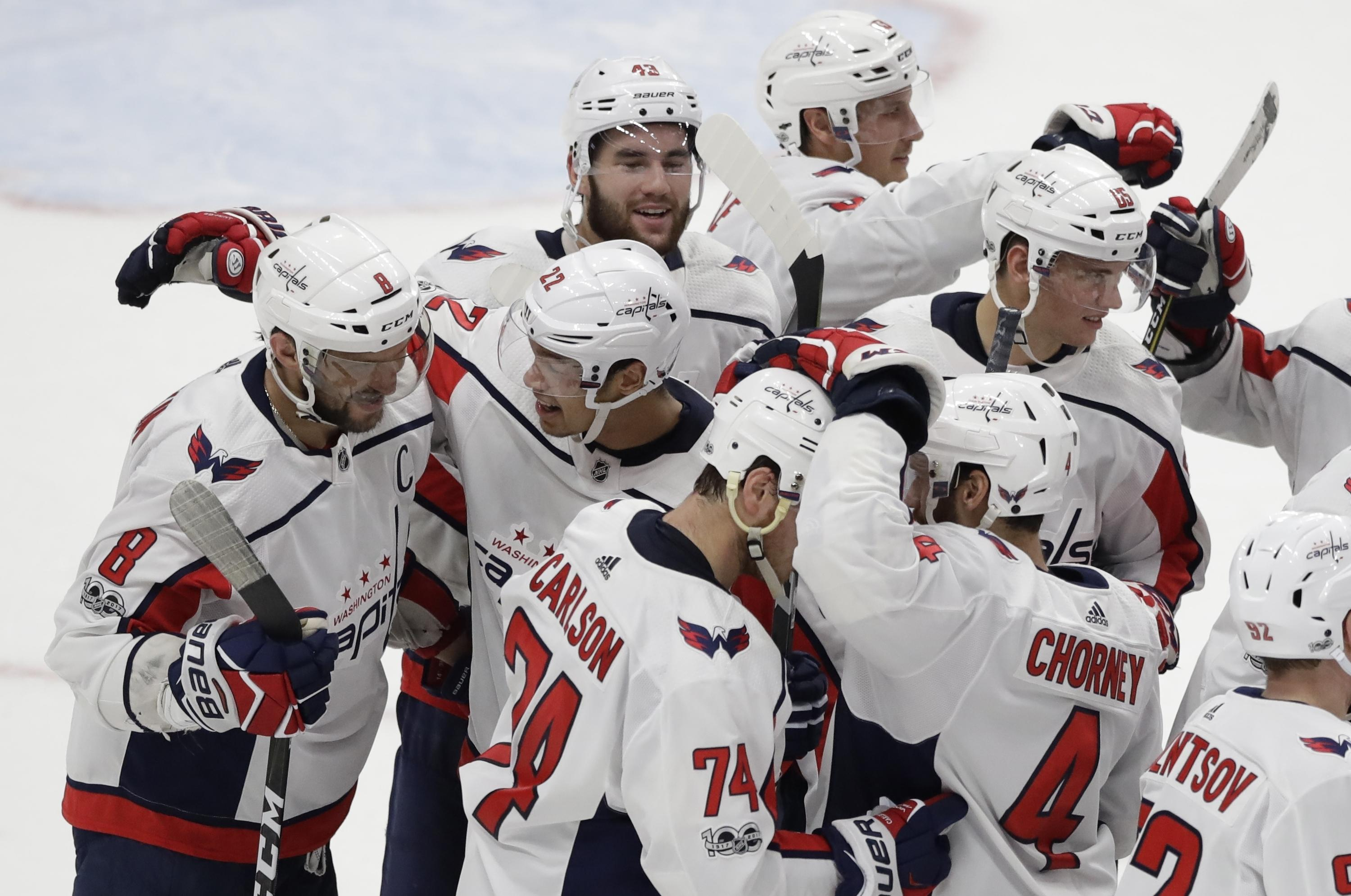 56a25a0795a Washington Capitals left wing Alex Ovechkin (far left) is congratulated by  teammates after scoring
