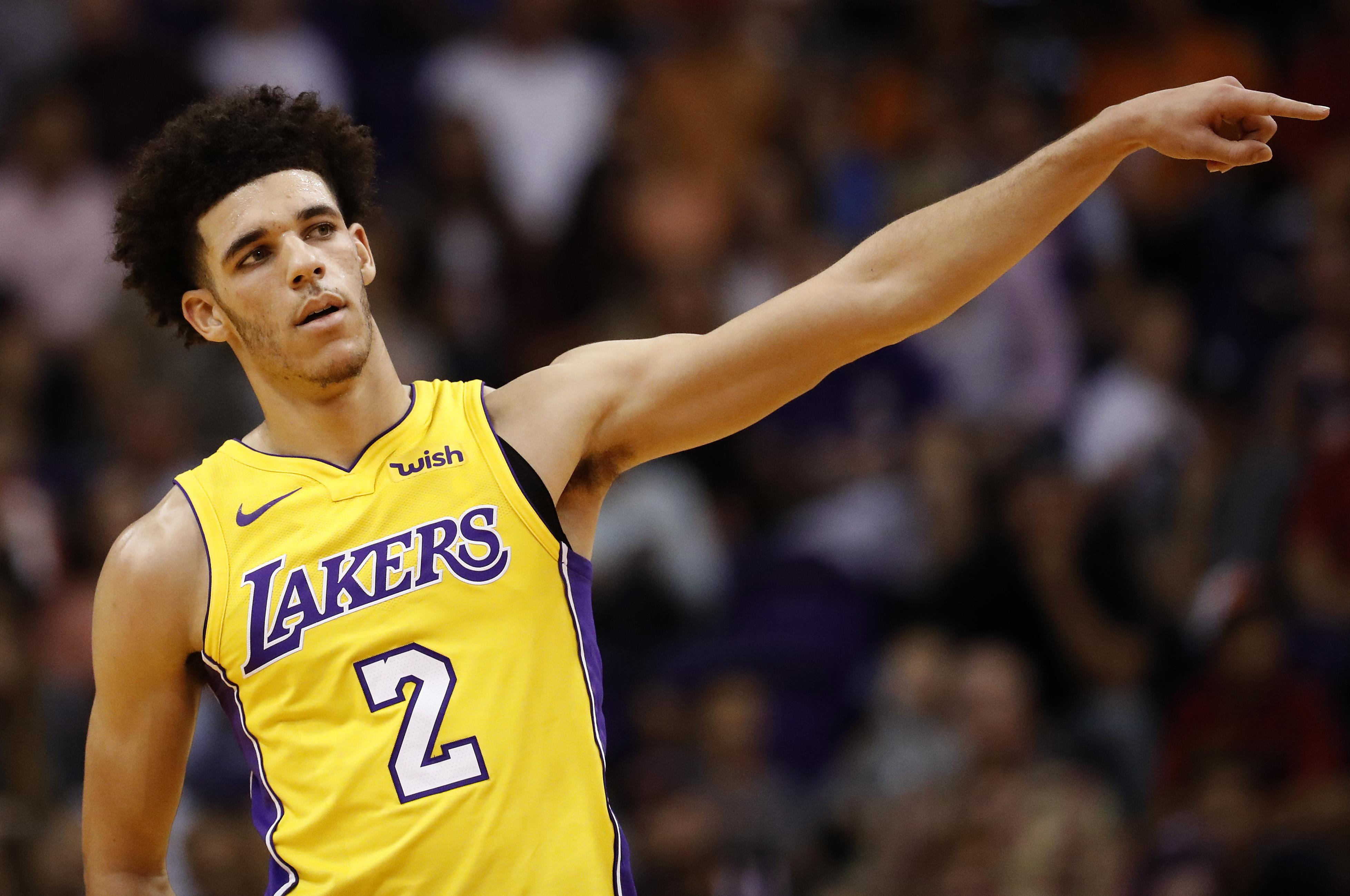 40f9e737633 Los Angeles Lakers guard Lonzo Ball gestures to teammates after scoring in  the first half of