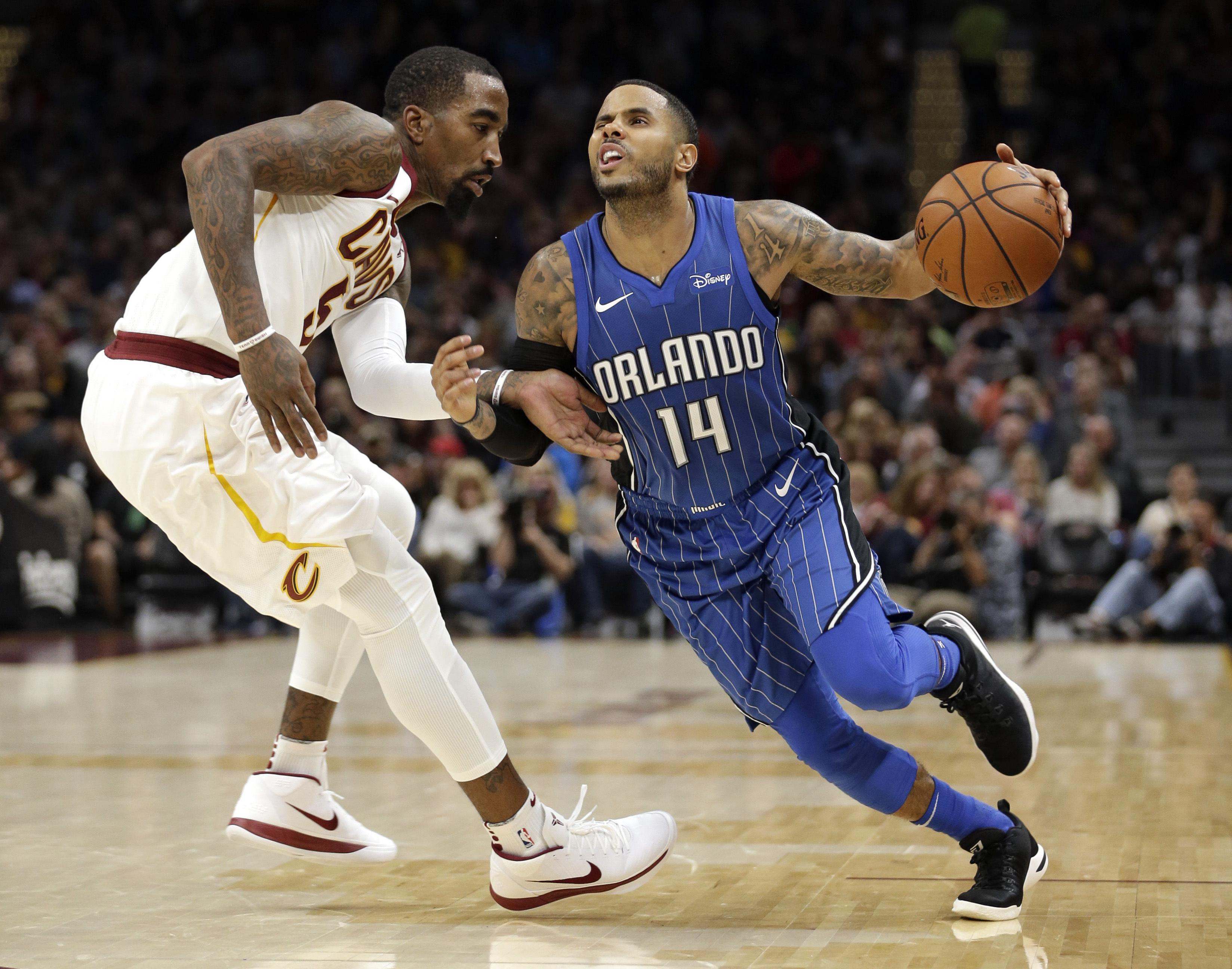 Orlando s D.J. Augustin drives past Cleveland s JR Smith in the second half  of Saturday s game. 99f1e8635