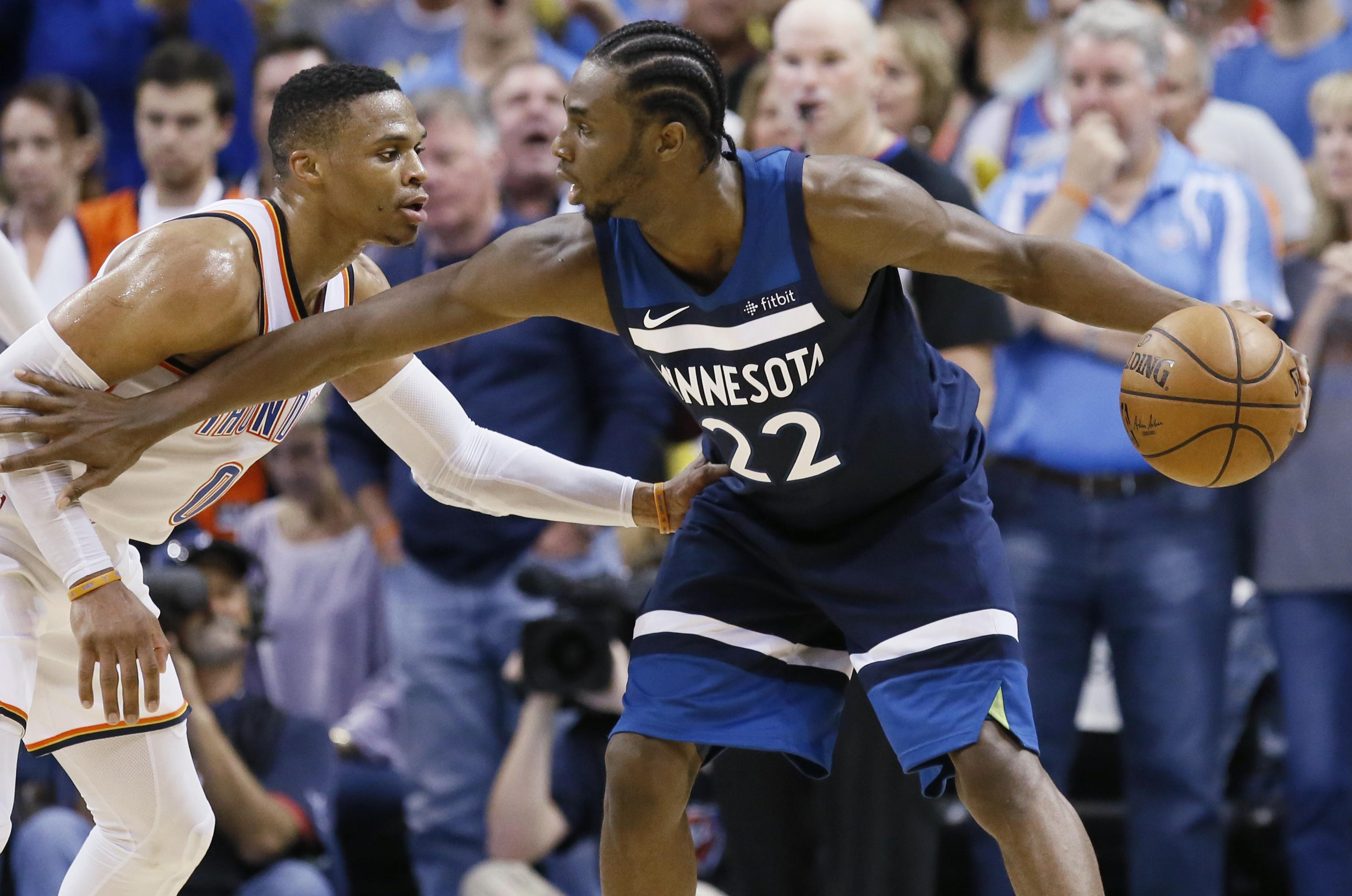 d1268eb47f8 Minnesota Timberwolves guard Andrew Wiggins, right, holds off Oklahoma City  Thunder guard Russell Westbrook