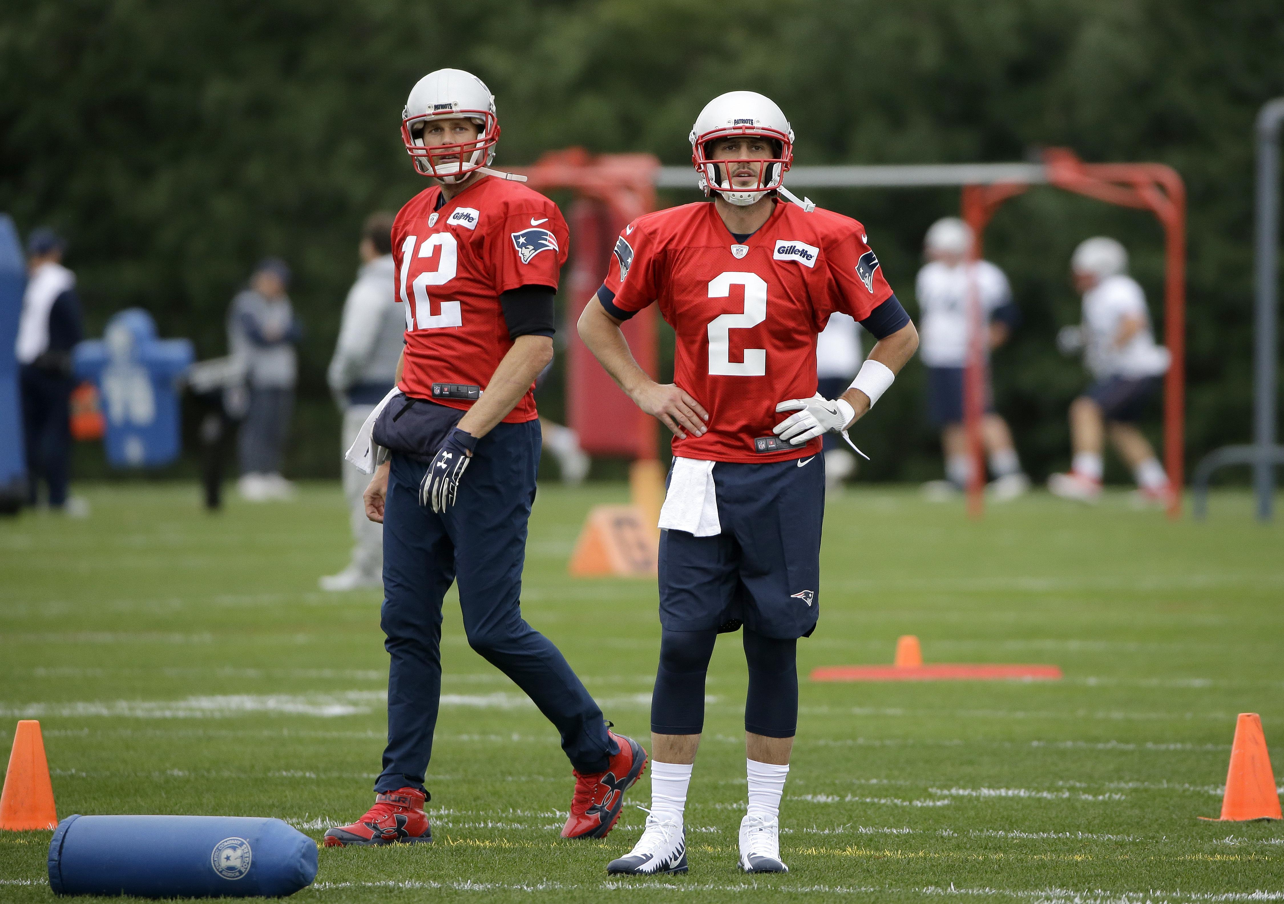 b2d91a613c6 New England Patriots quarterbacks Tom Brady (12) and Brian Hoyer (2) stand