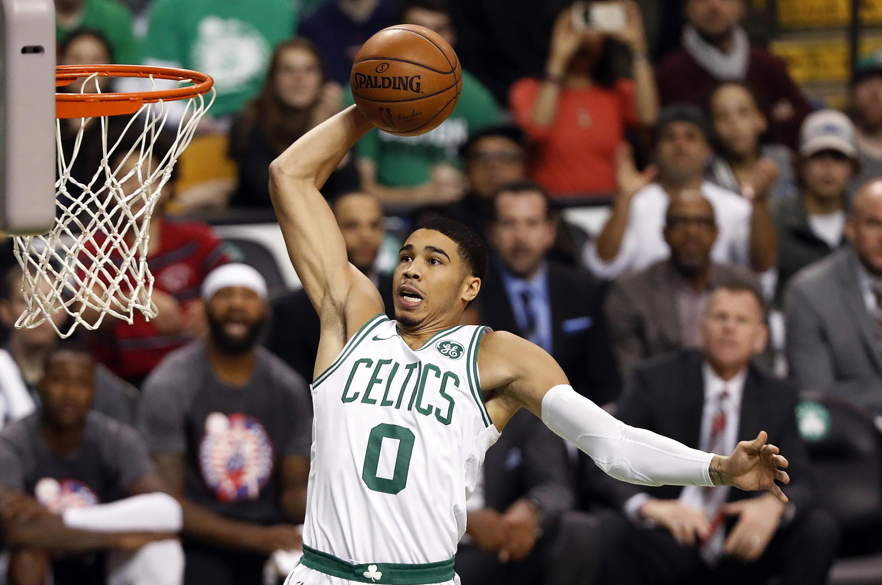 afa545cdeeb9 Boston Celtics  Jayson Tatum goes in for a dunk against the Toronto Raptors  during the