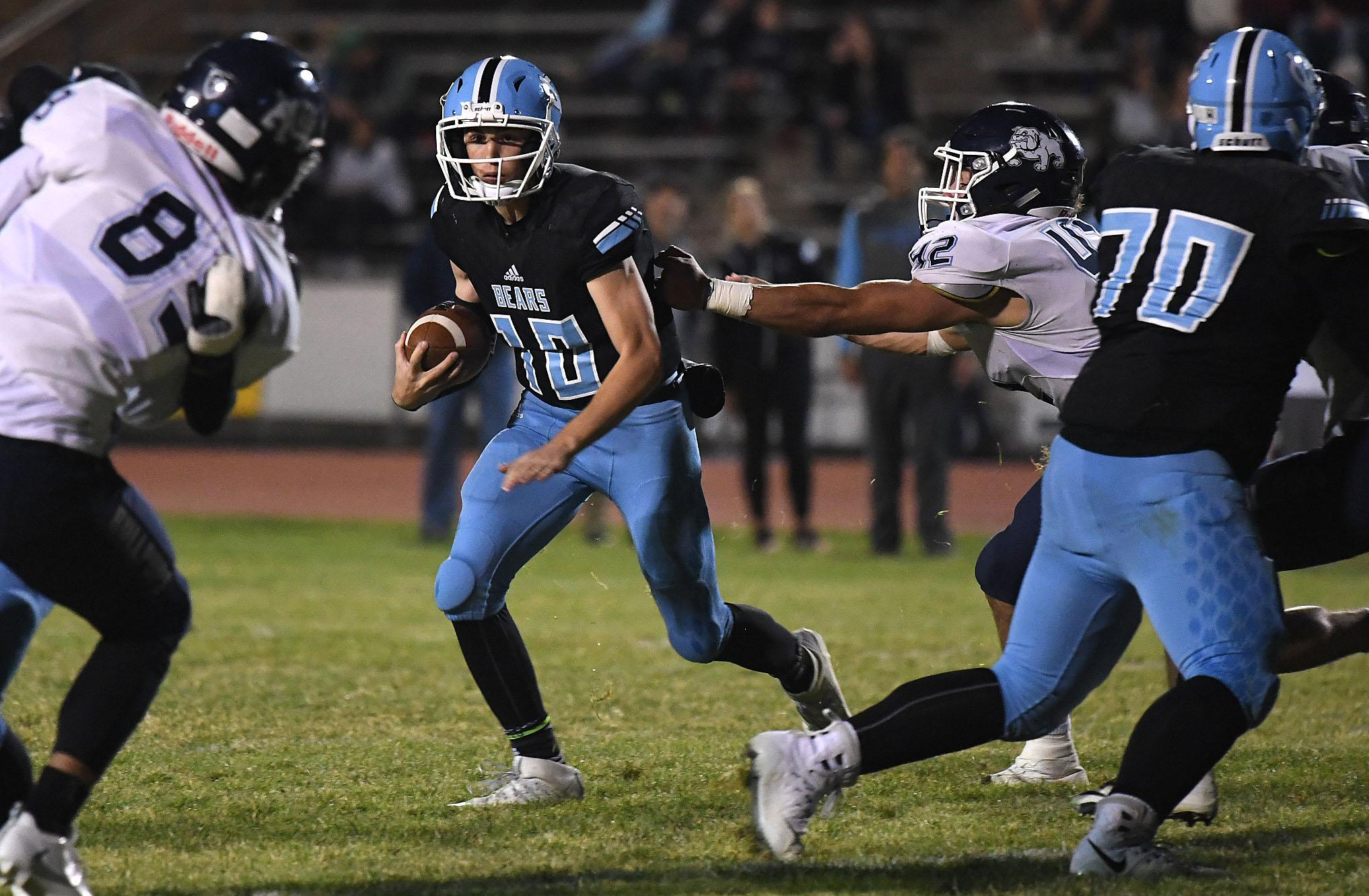 Central Valley quarterback Grant Hannan (10) scrambles during the second  half of a GSL