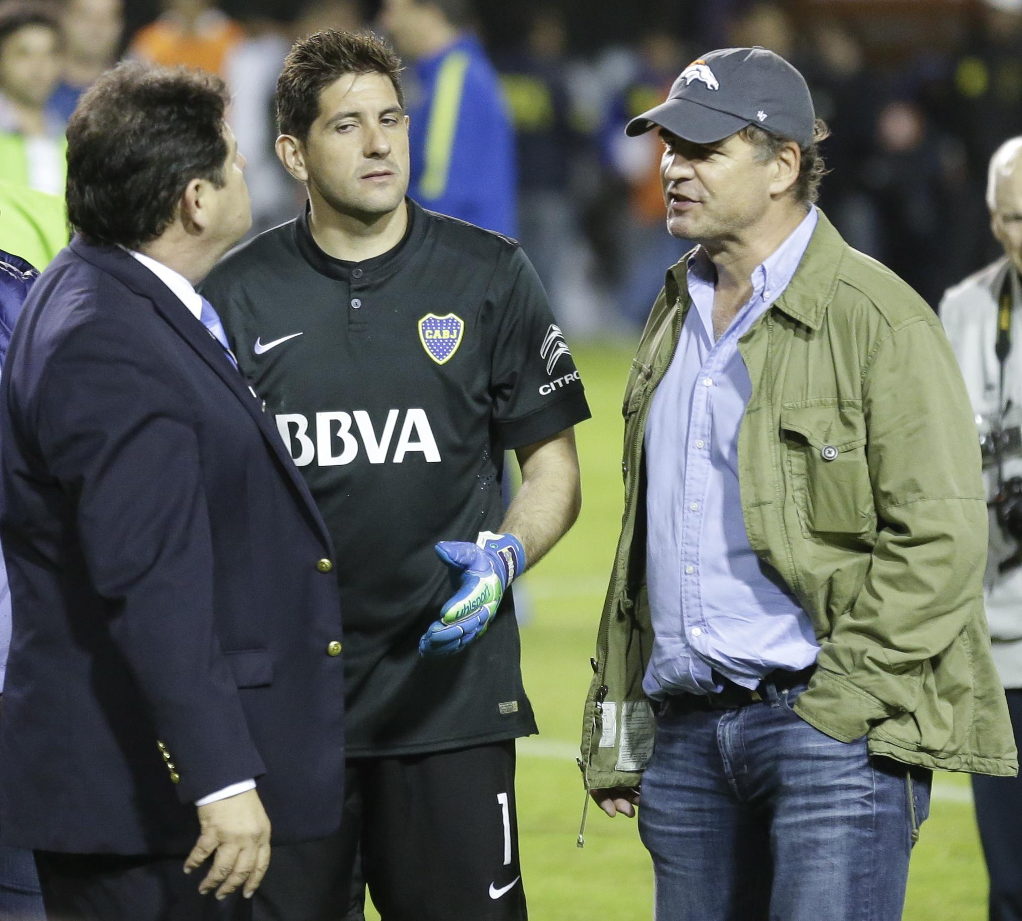 CONMEBOL delegate Roger Bello of Bolivia left talks with Boca Juniors goalkeeper Agustin Orion center and Alejandro Burzaco president of Torneos y Competencias during a Copa Libertadores soccer match