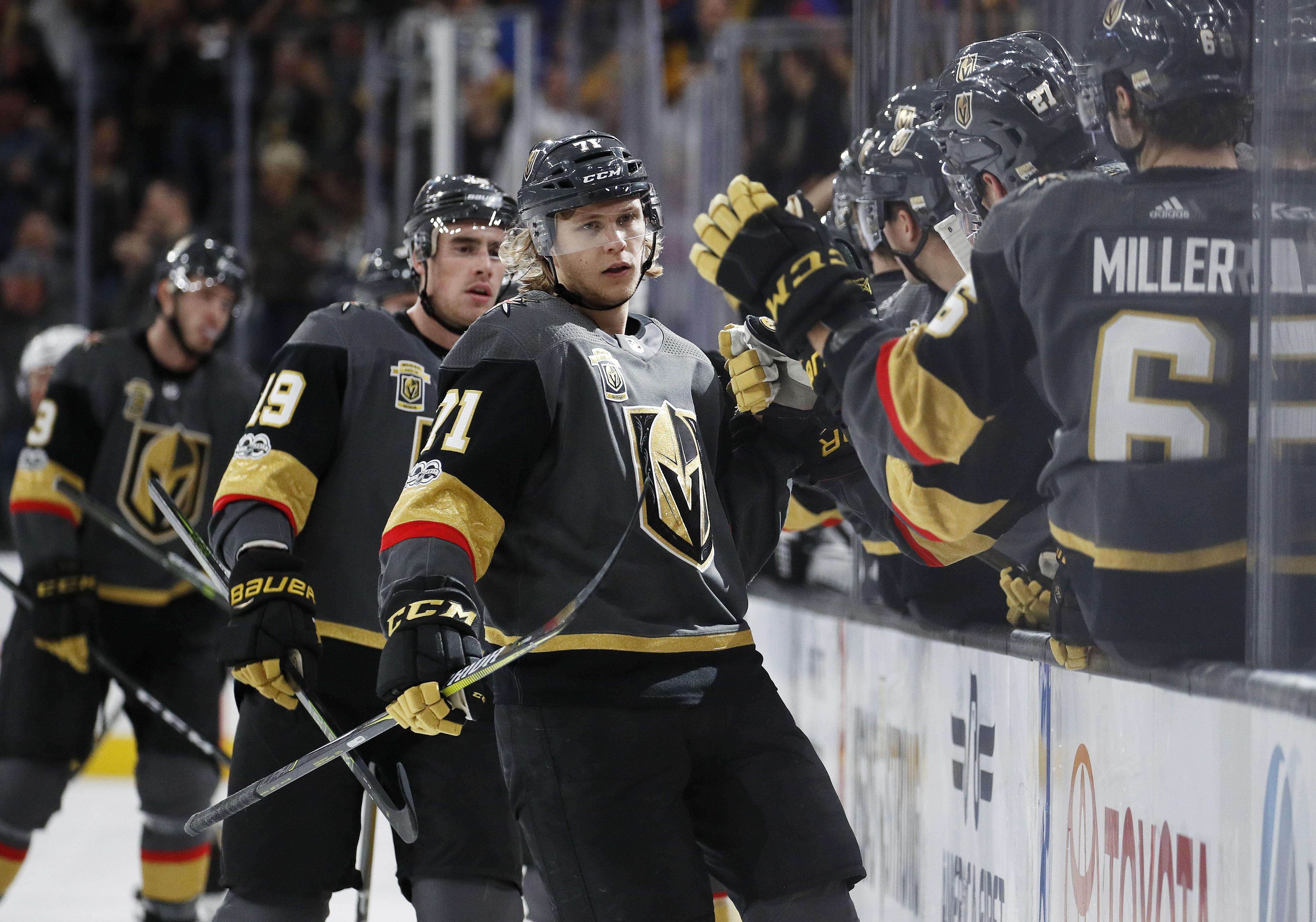 ef2d933e393 Vegas Golden Knights center William Karlsson, center, celebrates after  scoring against against the Los
