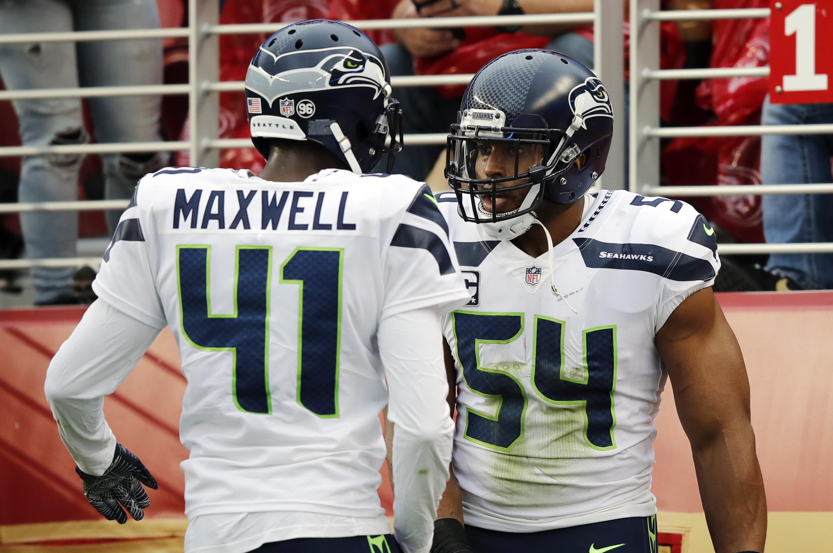 Seattle Seahawks middle linebacker Bobby Wagner (54) is joined by Byron  Maxwell as they 683f59213