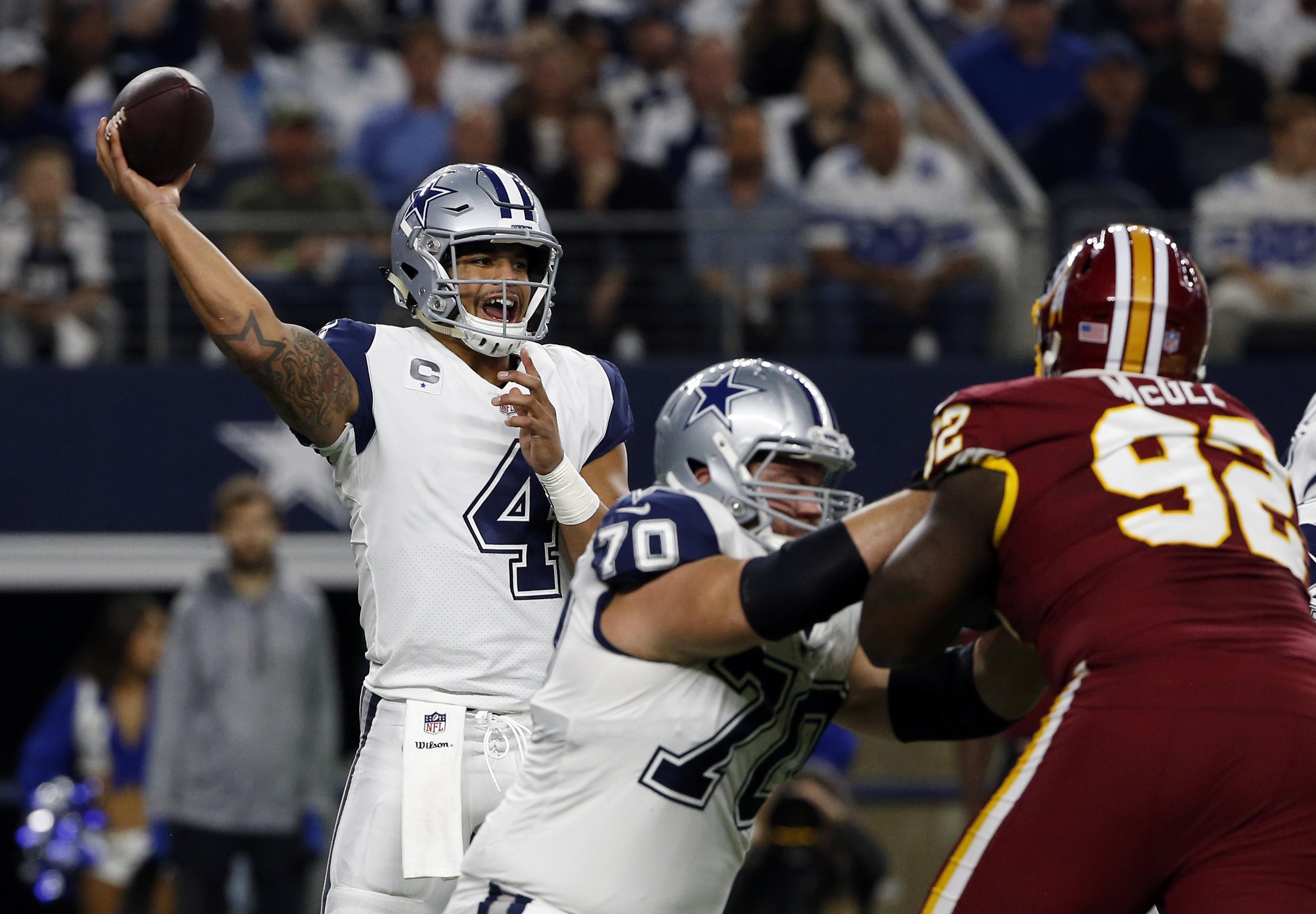 b32df7f8d Dallas Cowboys quarterback Dak Prescott (4) throws a pass as guard Zack  Martin (