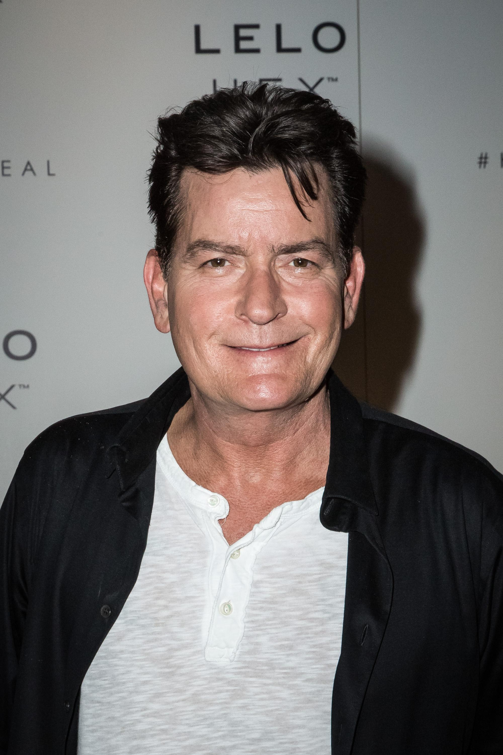 Charlie sheen sues tabloid over assault allegation the spokesman american actor charlie sheen ambassador of the condom brand lelo hex poses thecheapjerseys Image collections
