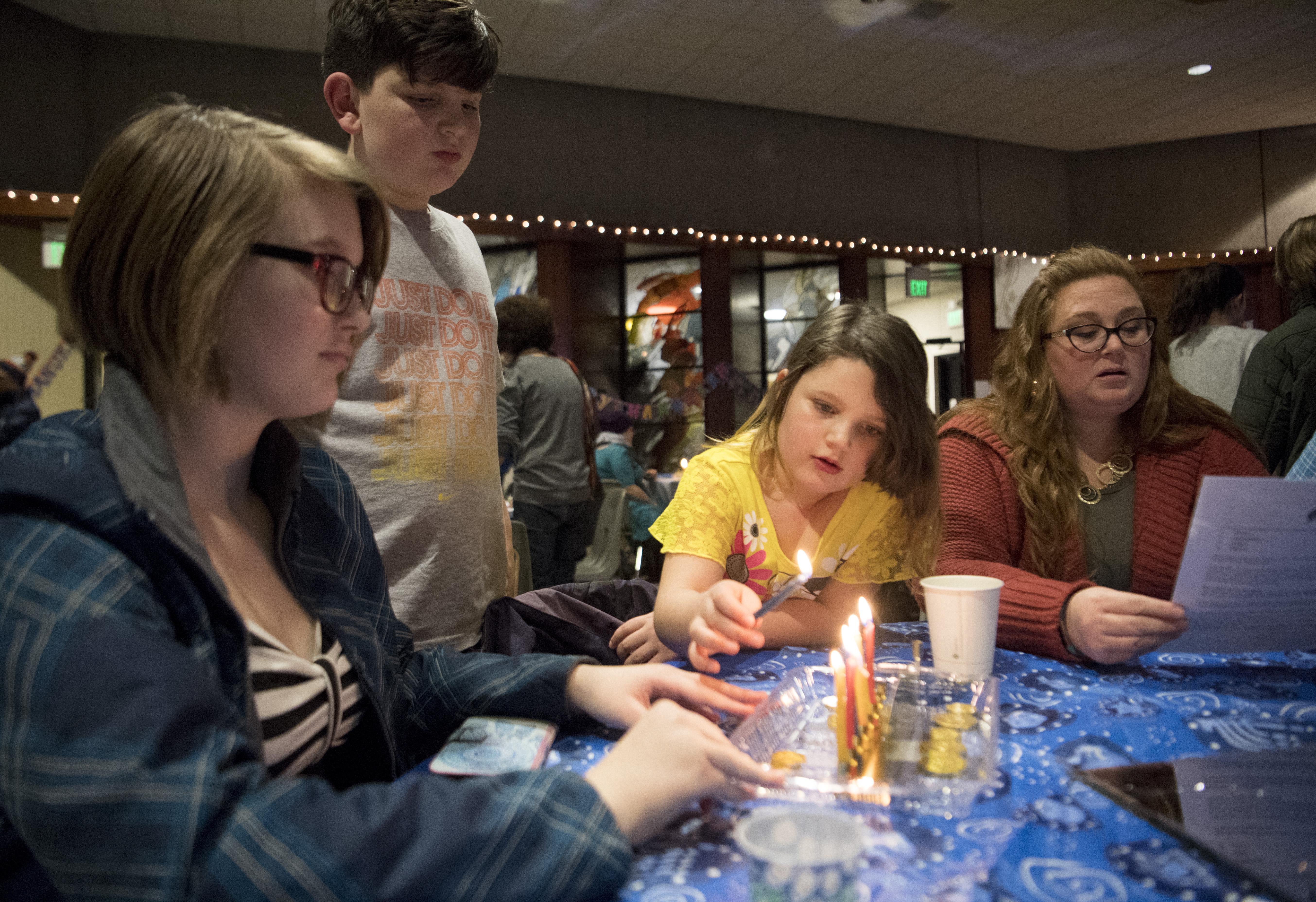 Hanukkah Party Celebrates Lighting Of The Menorah At