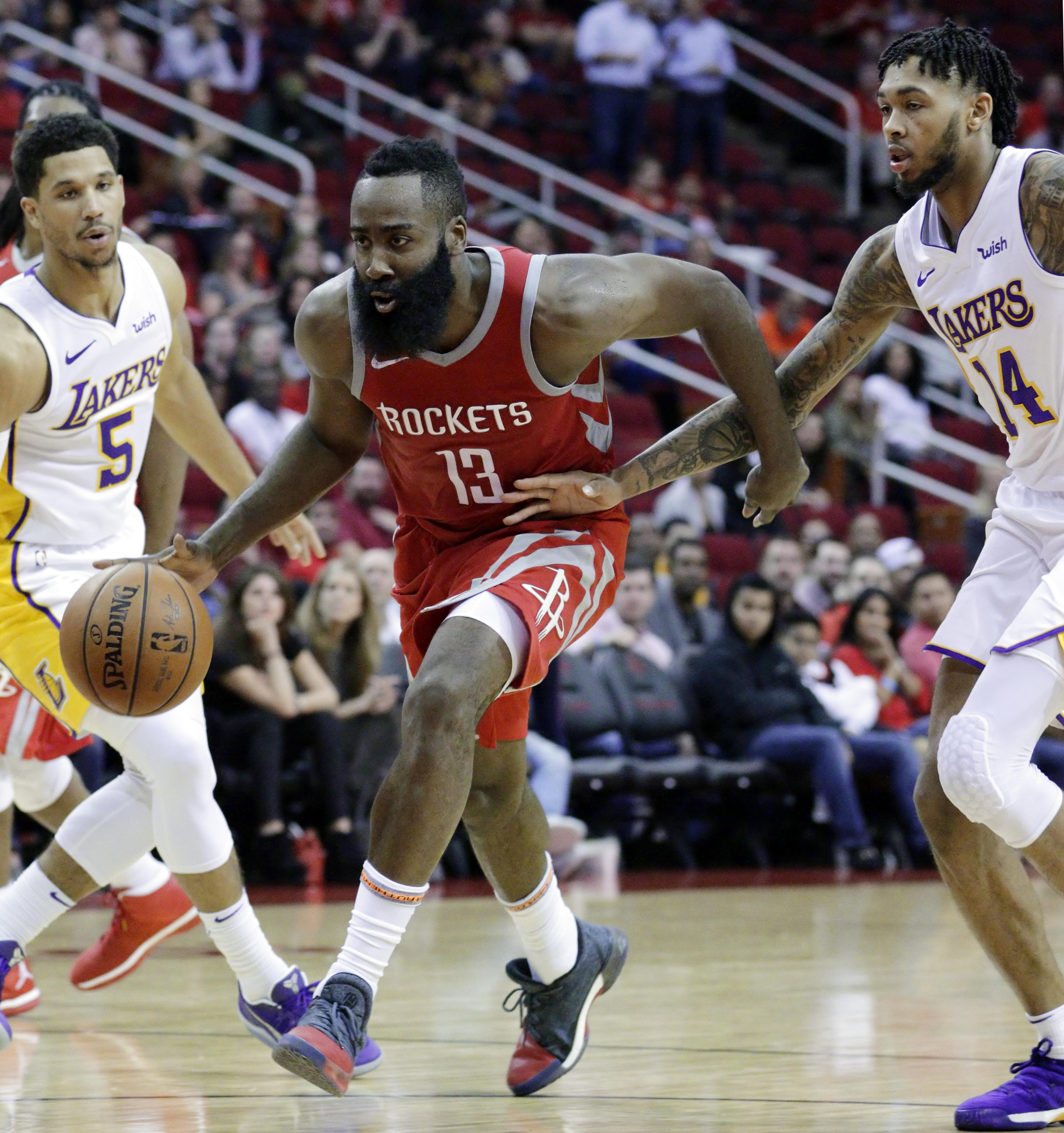 eac18b77c Houston Rockets guard James Harden (13) drives between Los Angeles Lakers  guard Josh Hart