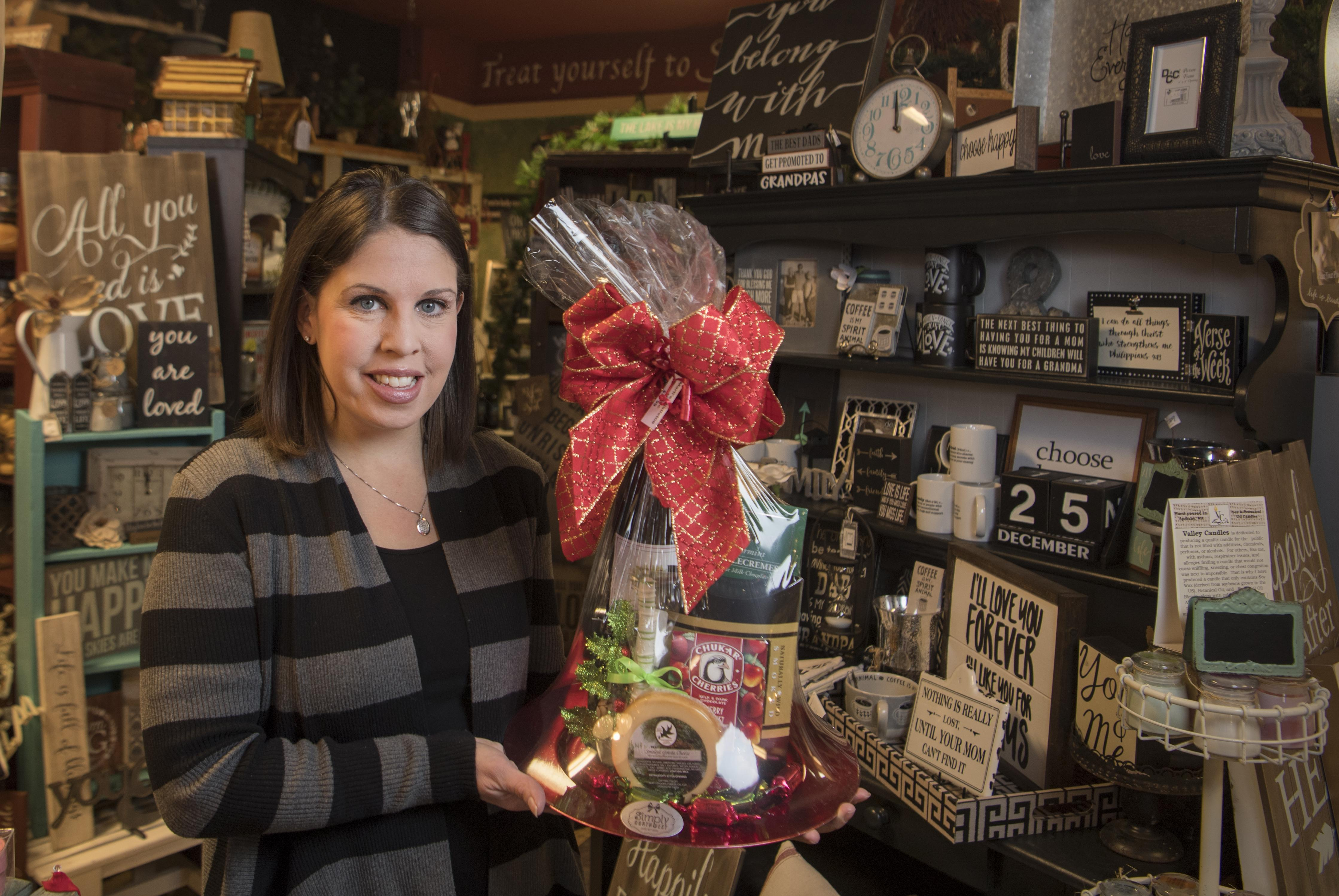 Denielle Waltermire Stuhlmiller holds a signature gift basket in her gift shop, Simply Northwest,